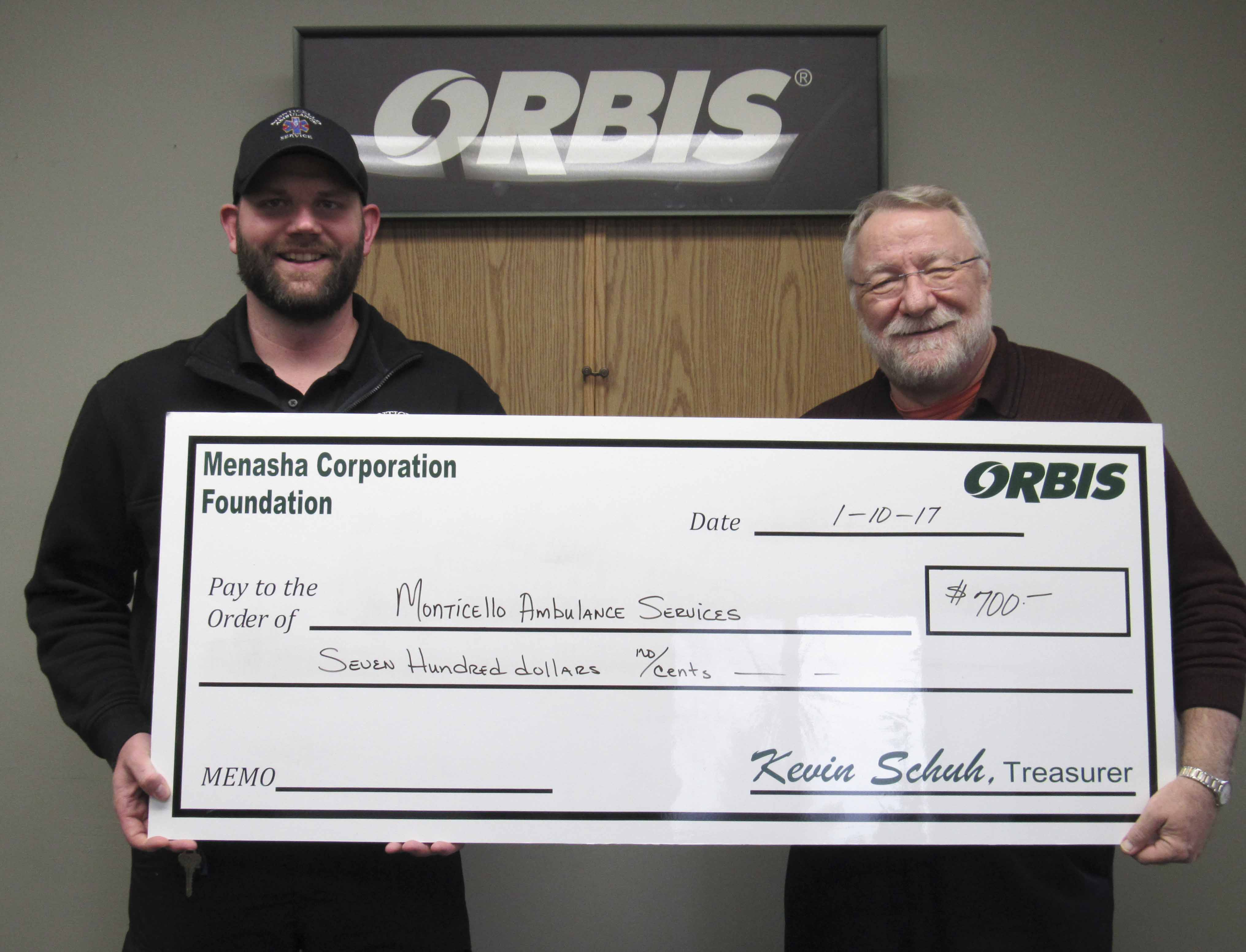 Orbis in Monticello recently donated funds to several community entities, including the Monticello Ambulance Service. Accepting on behalf of the ambulance department is Chris Sampson (left). Orbis, represented by Richard Talcott, donated $700. (Photos by Kim Brooks)