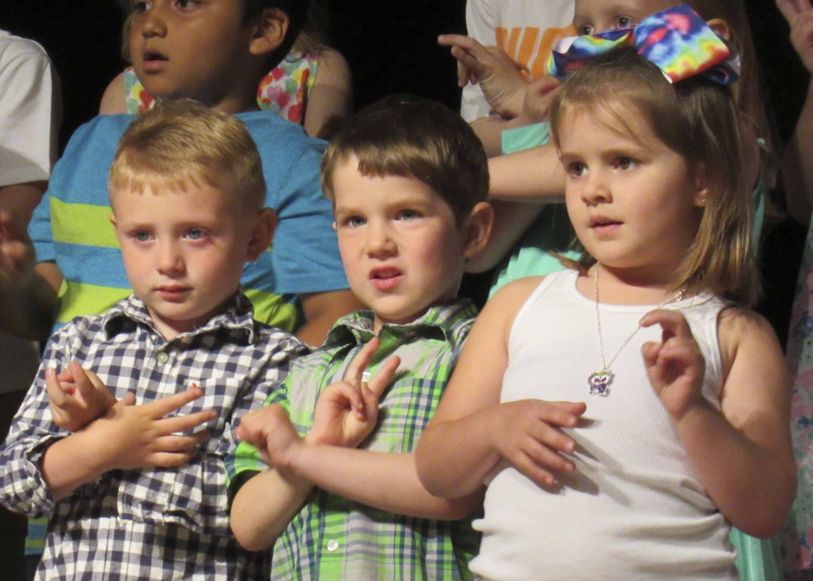 Preschoolers Blake Shover, Tripp Culver and Eden Stoneking perform a song during their preschool graduation ceremony at MHS. (Photos by Kim Brooks)