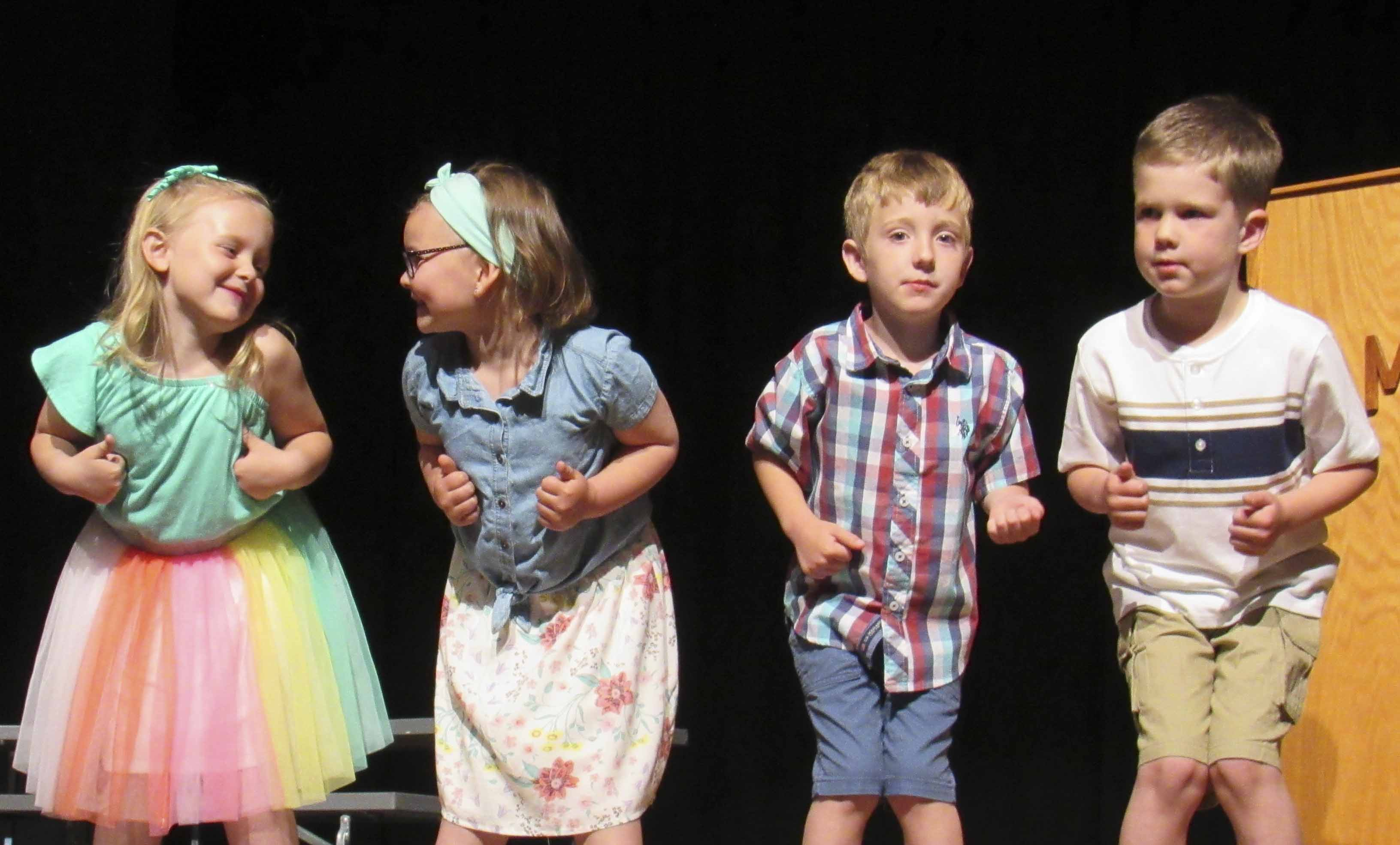 The Monticello preschoolers had fun singing silly songs during their May 17 graduation ceremony. Getting into the actions from left are Scarlett McDermott-Ray, Morgan Quinn, Ryker Hardin, and Isaac Reade.