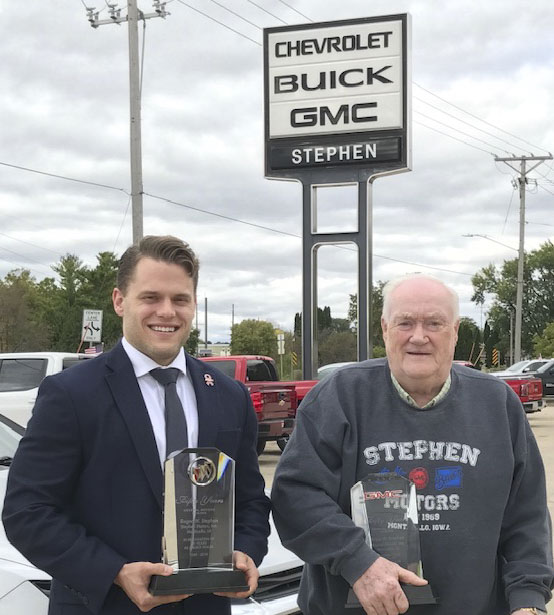 Roger Stephen, owner of Stephen Motors in Monticello, was recently presented awards for 50 years as a dealer for GMC and Buick. Stephen has been a dealer for these brands since 1969, and for Chevrolet since 1985. Garrett Stuart, Chevrolet district sales manager, presented Stephen with the awards. (Photo submitted)