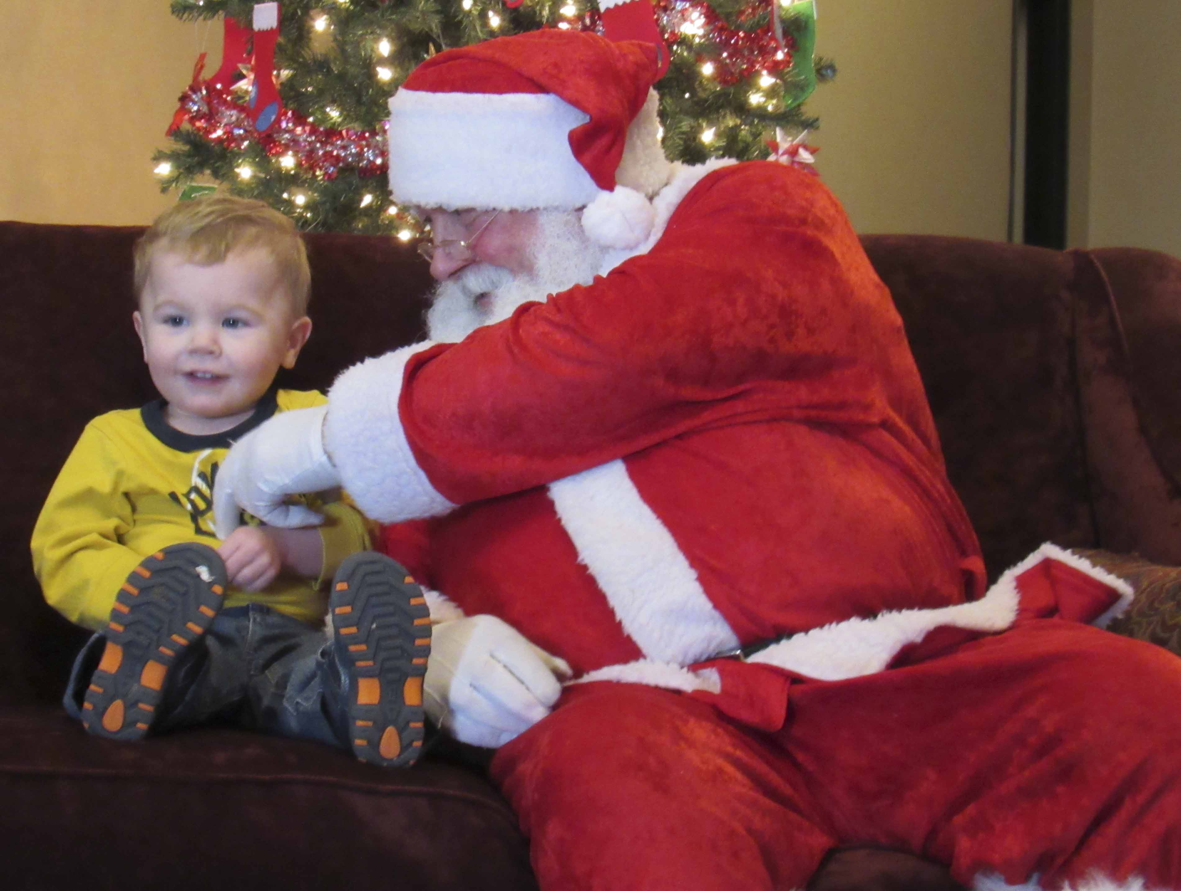 Evan Fitzpatrick was excited to see Santa Claus on Dec. 9. The Monticello Area Chamber of Commerce welcomed Santa to town for all to see. He will be back in Monticell on Dec. 12 and 14, 4:30-6:30 p.m. (Photos by Kim Brooks
