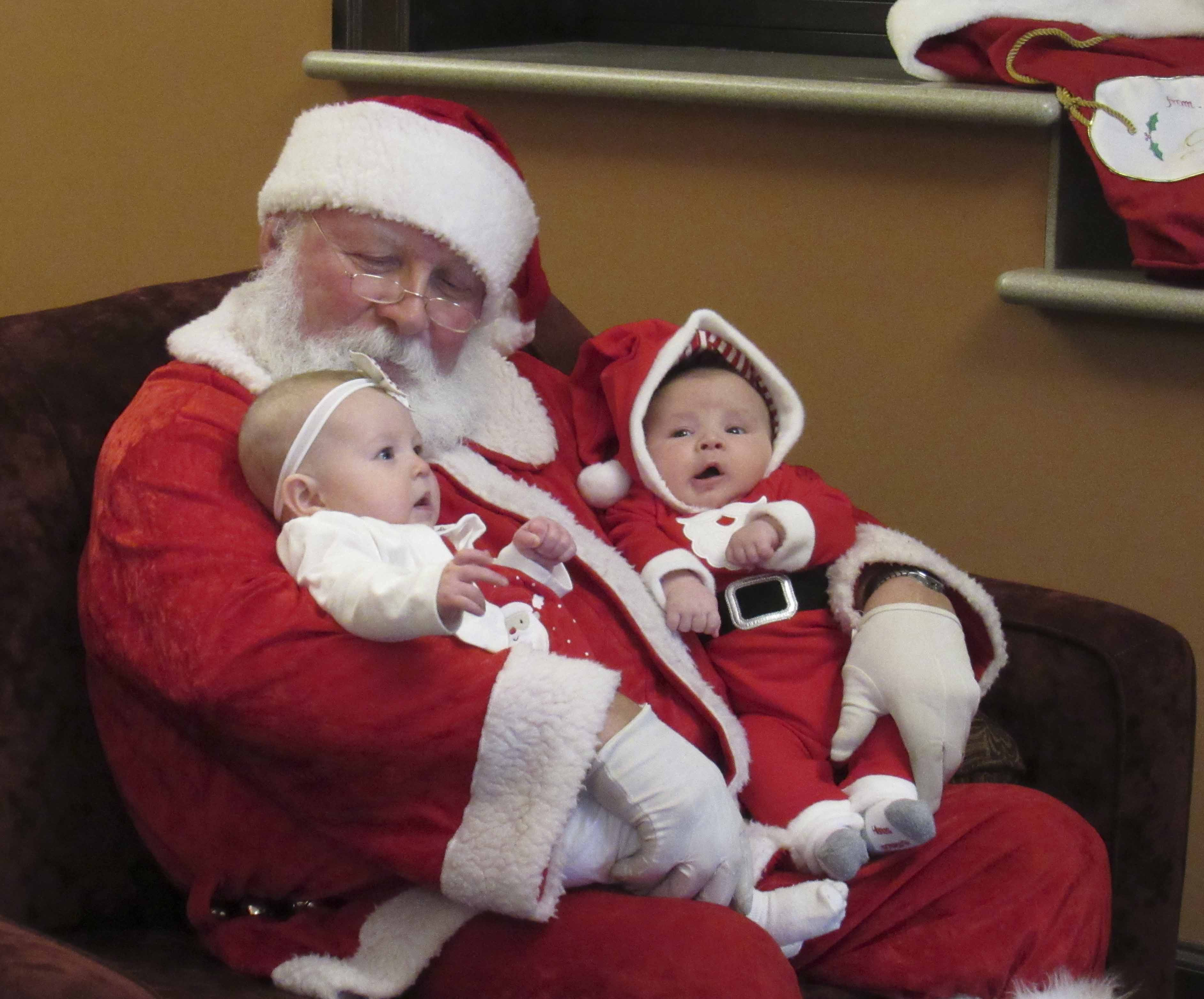 Harper Smith and Max Luensman were the youngest visitors the morning of Dec. 9 to see Santa at City Hall in Monticello.