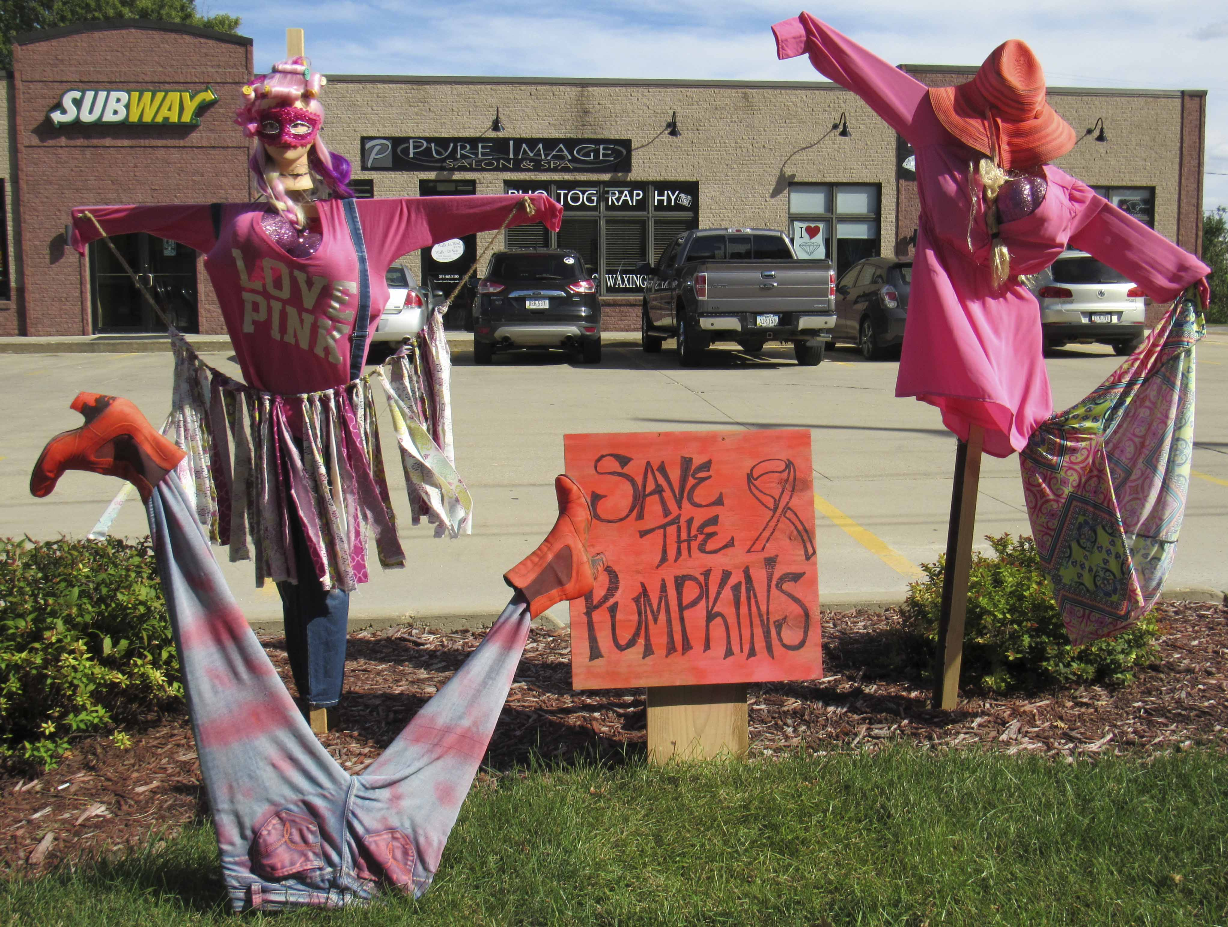 "Pure Image Salon & Spa displayed their unique and creative scarecrows in front of Armin Plaza with the theme ""Save the Pumpkins"" in honor of Breast Cancer Awareness Month (October)."