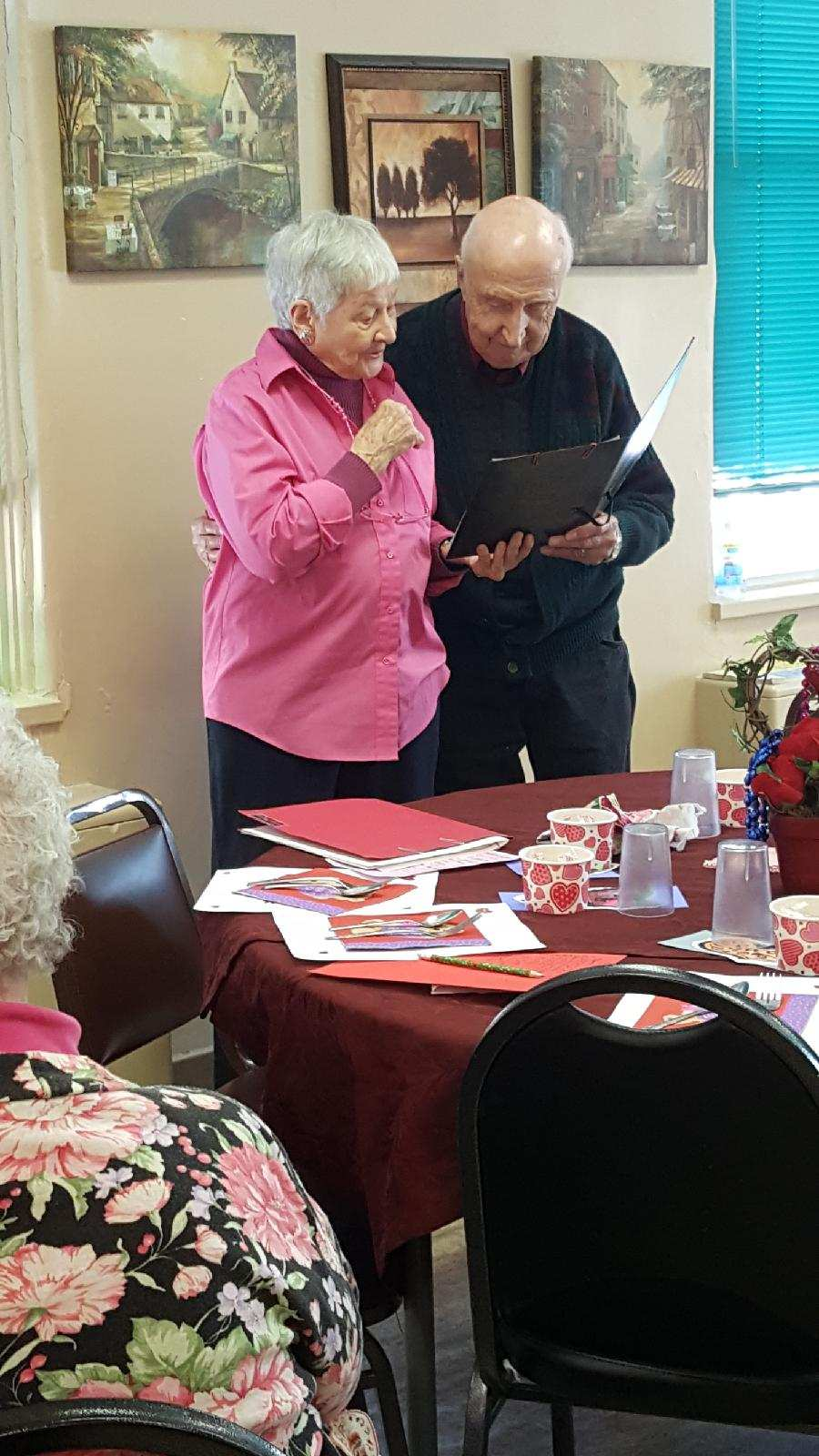 Julie and Al Carlson sing love songs at the Senior Dining site in Monticello on Valentine's Day, Feb. 14.