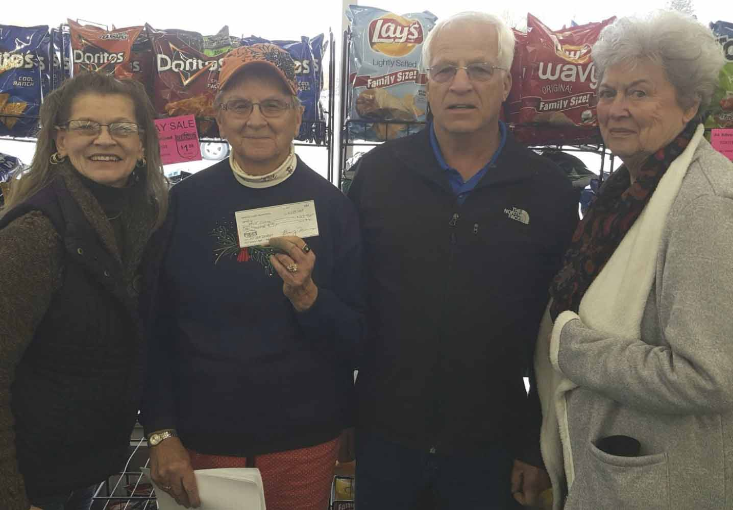 Jones County Senior Dining held its annual food drive and fundraiser at Fareway on Oct. 28. To assist in the efforts, the Jones County Dairy Producers donated $1,000. From left are Regina Engelbart, Monticello dining site manager; Janaan Kraus, senior dining volunteer; Kevin Miller, Dairy Producers; and Sue Brokaw, Senior Dining volunteer. (Photo submitted)