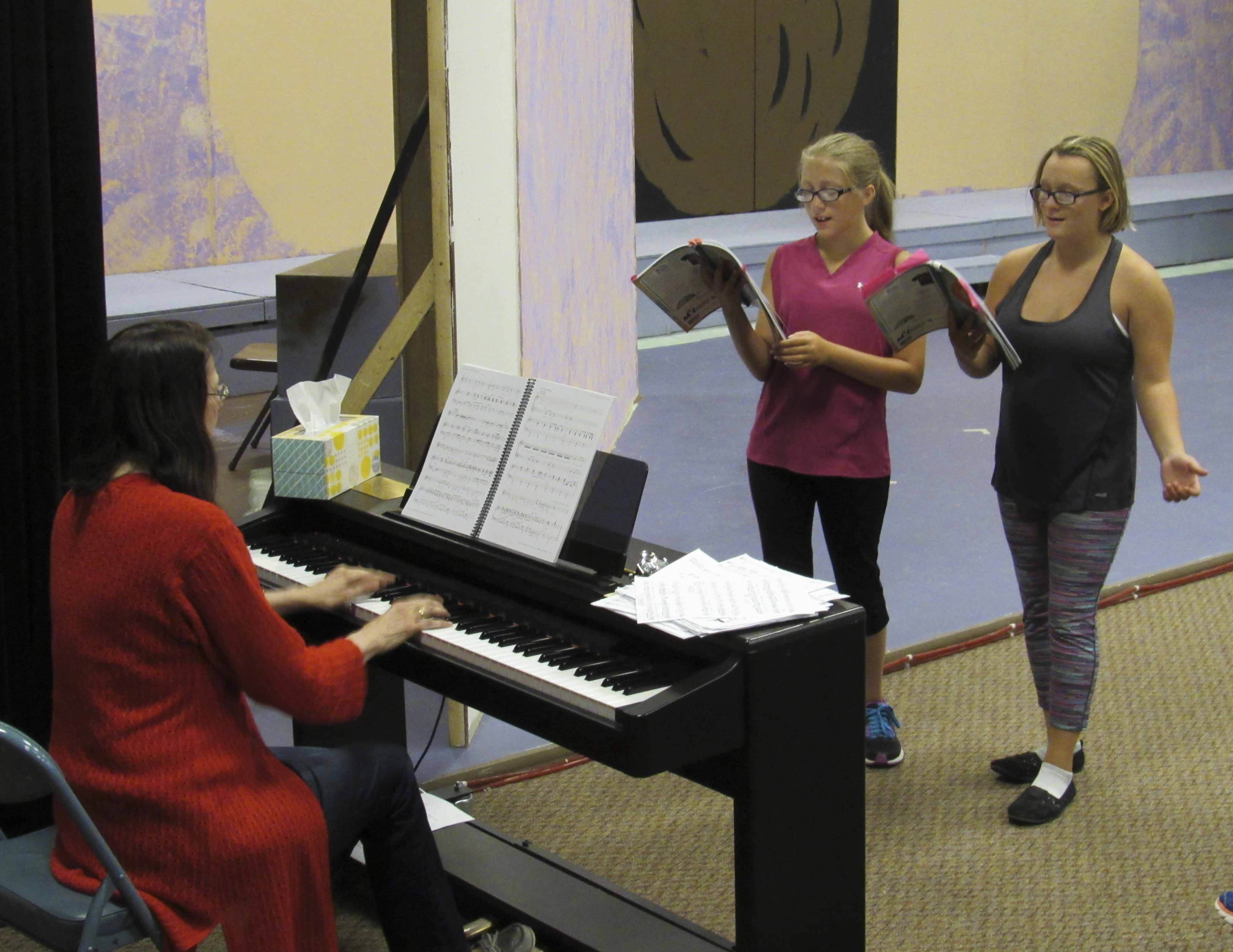"Practicing their musical numbers for Starlighters' children's theater ""James and the Giant Peach"" are Daylor Miller and Kat Edler with musical director Janet Bergman."