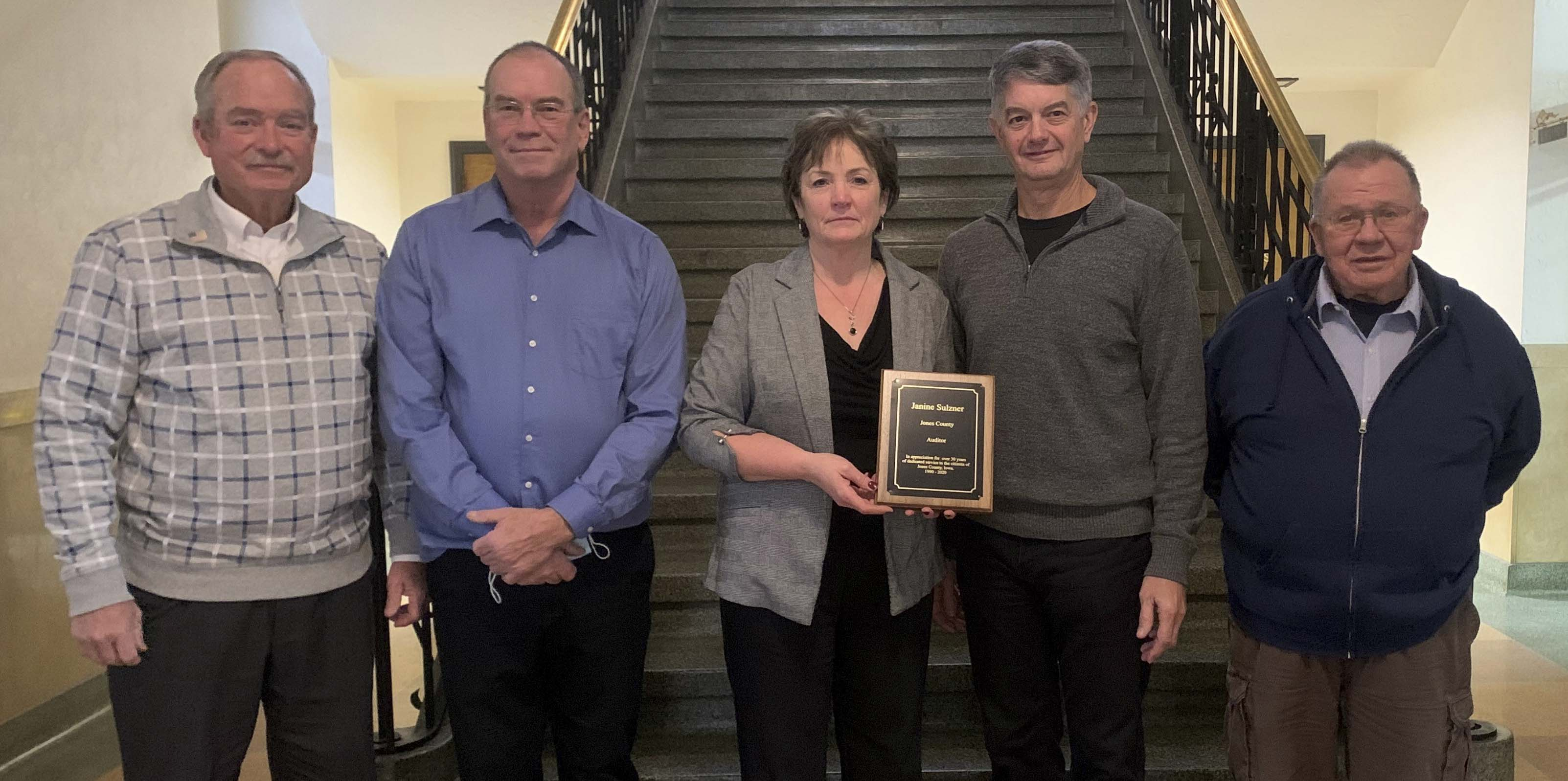 The Jones County Supervisors presented Janine Sulzner with a plaque, thanking her for her 30 years of service and dedication to the county as auditor. Sulzner retired on Dec. 31. From left are Ned Rohwedder, Jon Zirkelbach, Sulzner, Joe Oswald, and Lloyd Eaken. (Photo submitted)