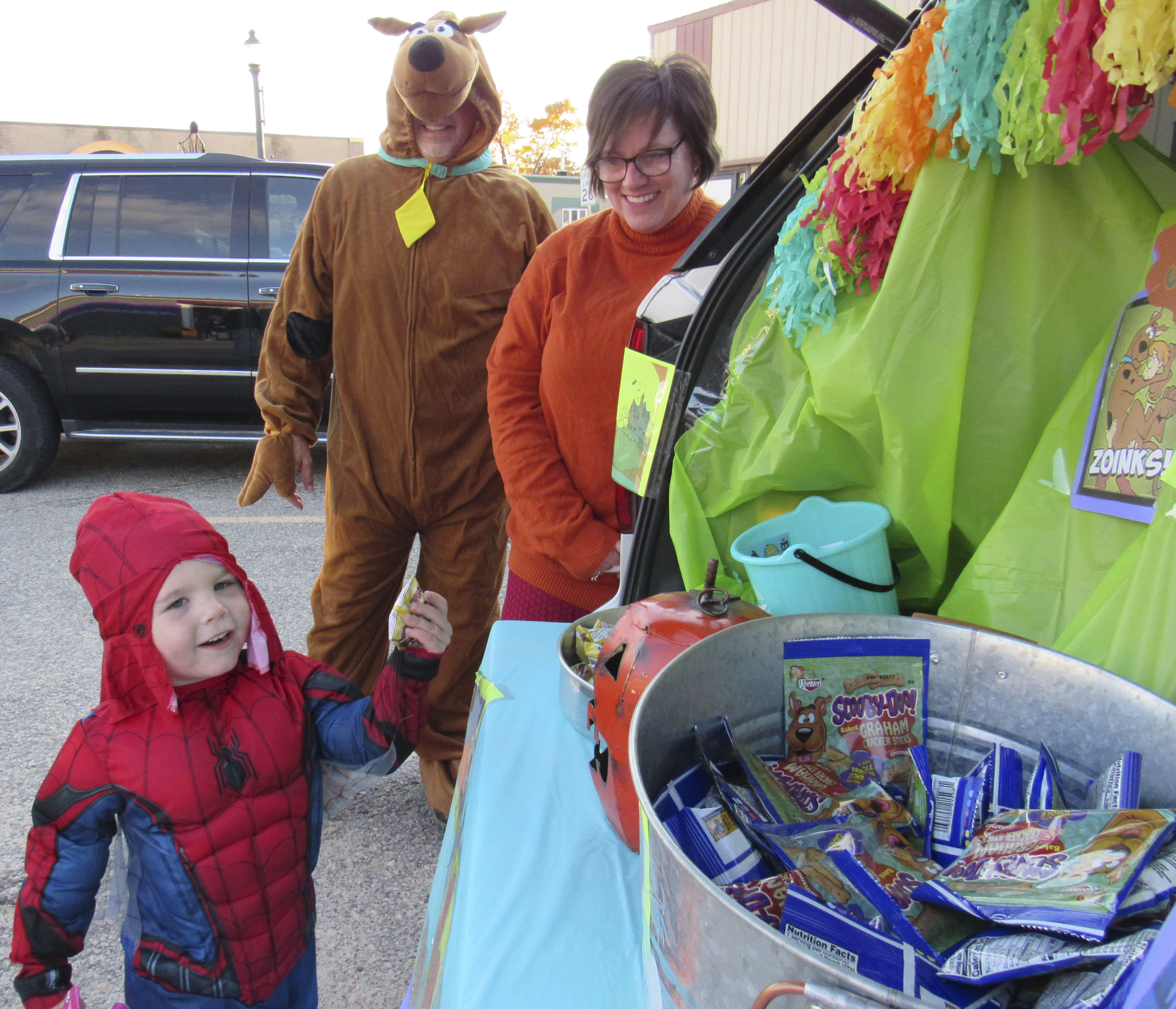 Evan Fitzpatrick gets his Scooby snacks from Scooby Doo and Velma (Bryan and Kris Barnhart) with All Seasons Auto Body. Several businesses were present in the downtown district for Monticello's annual Treats on the Streets event. (Photos by Kim Brooks)