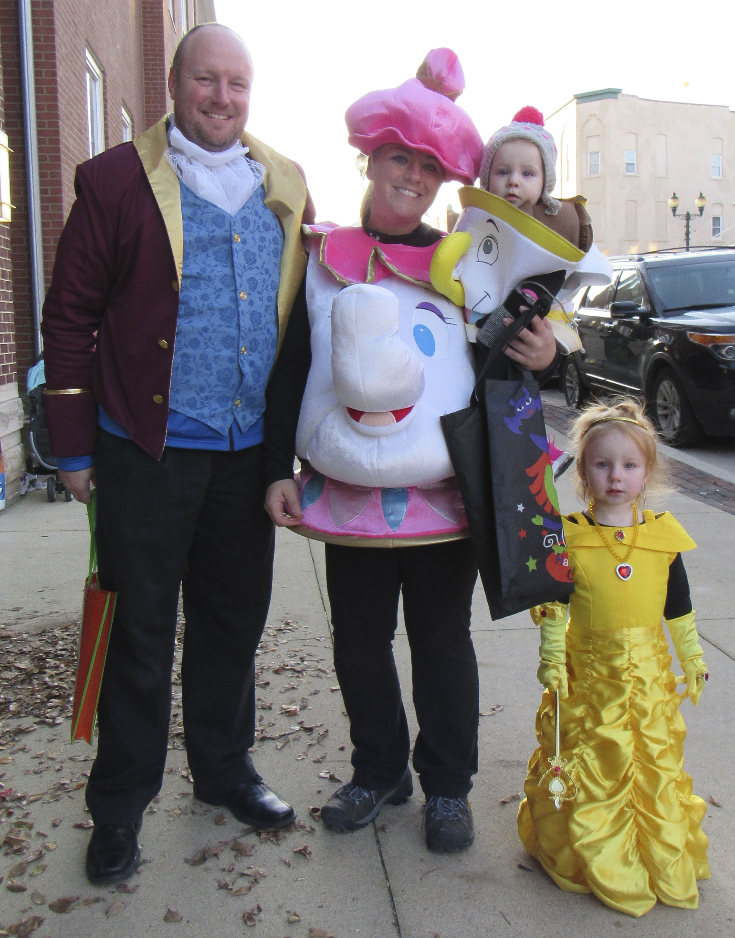 "Treats on the Streets was held in downtown Monticello on Oct. 24. Getting into the Halloween spirit were the Freye family dressed as characters from ""Beauty and the Beast:"" Tyler, Jayme holding McKenna, and Breleigh."