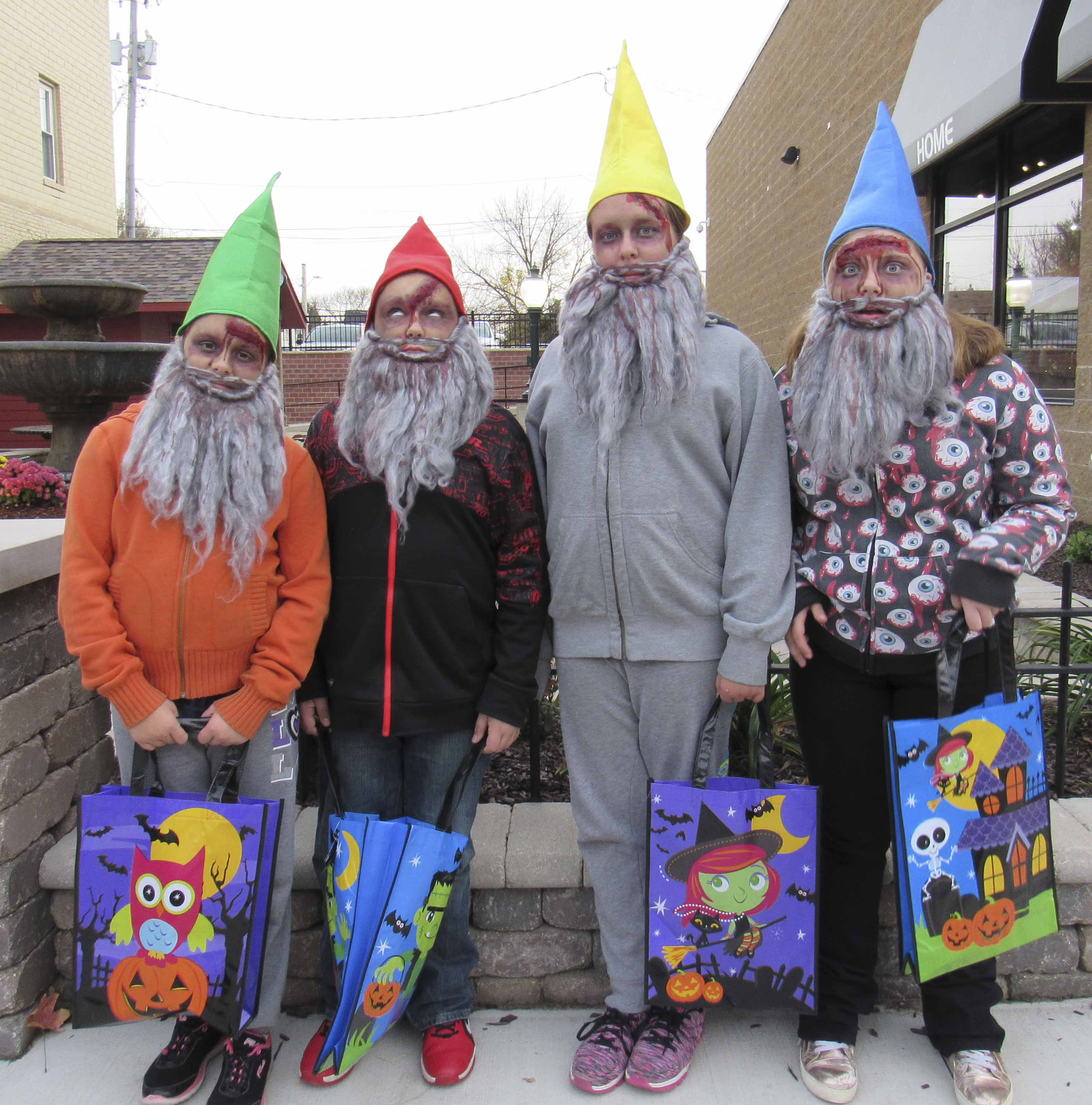 The walking dead gnomes pose for a picture in front of the downtown pocket park during Treats on the Streets. From left are Lexi Gaal, Preston Schultz, Destiny Gaal, and Alexis Schultz.