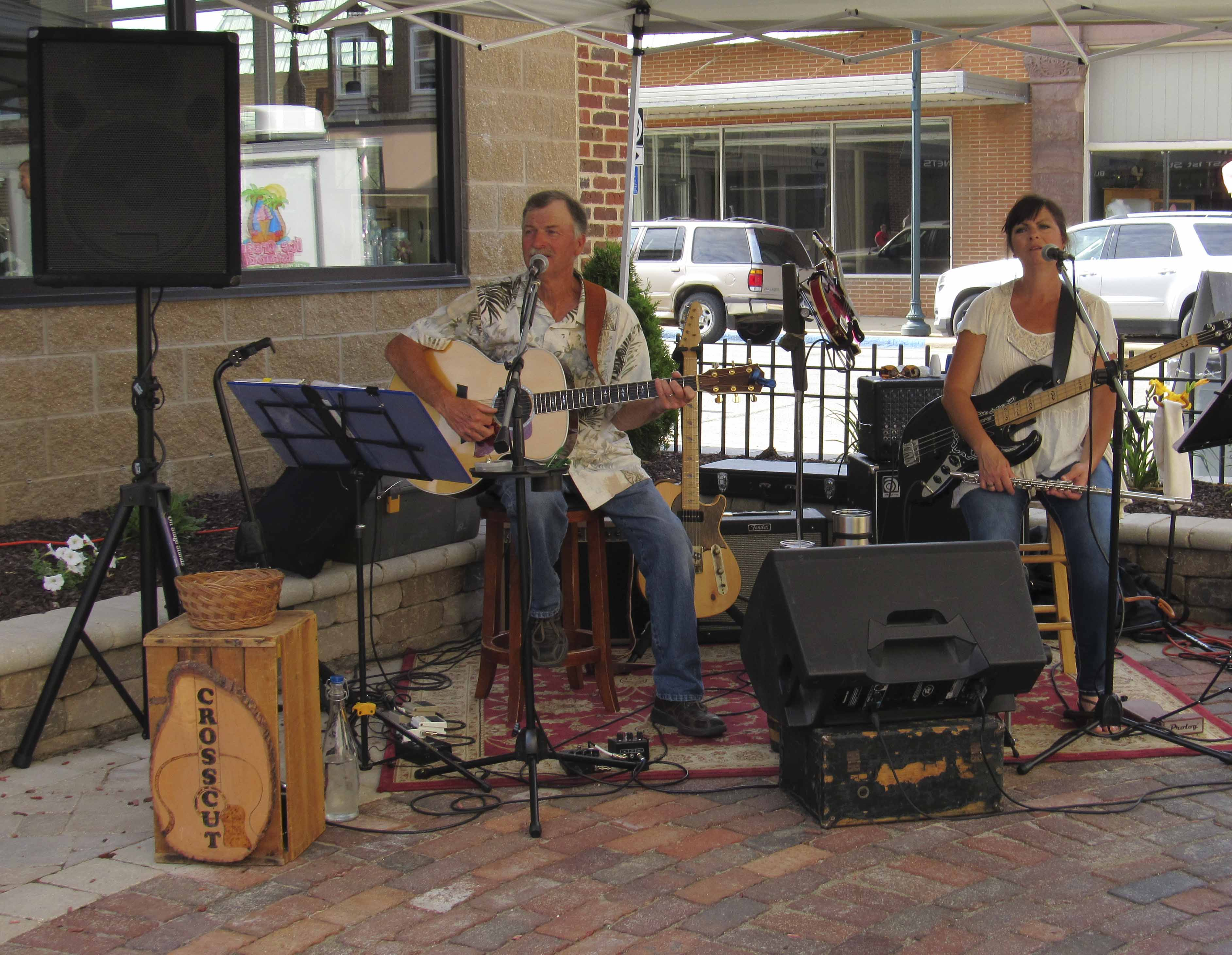 Popular local band Crosscut performed at Monticello's first Uptown Thursday Night on June 22. The event was held at the downtown pocket park. Dennis Chapman and Sheree Doyle make up Crosscut. (Photos by Kim Brooks)