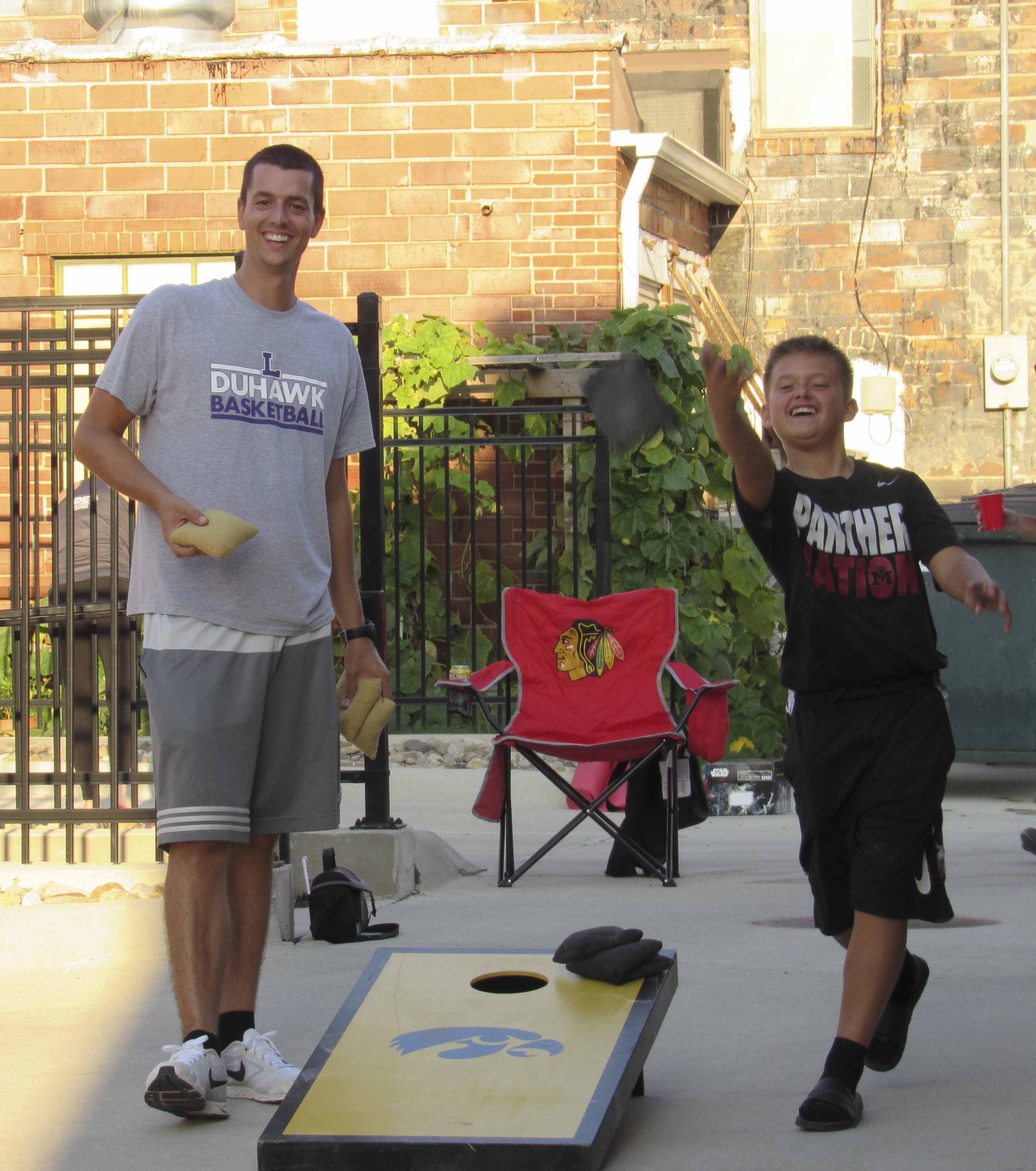 The Monticello Parks and Recreation Department held a beanbag toss tournament Sept. 21 at Uptown Thursday Night. Multiple teams competed. Here, Parks and Rec Director Jacob Oswald competes against Riley Norton.