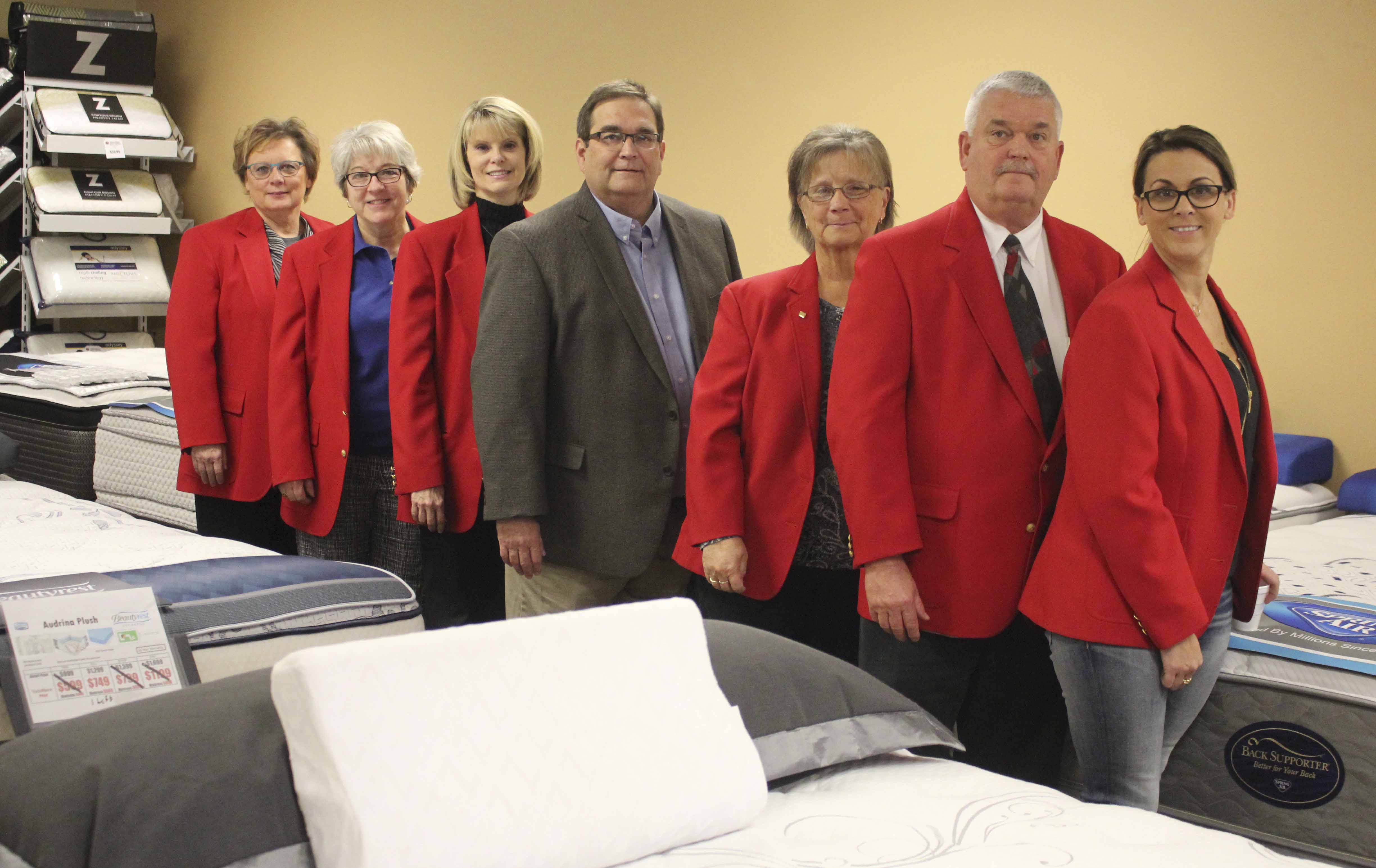 The Monticello Ambassadors visited Jim Flynn (center), new owner of ValuMaxx Mattress on W. First St., on Nov. 2. From left are Ambassadors Suzan Ehlers, Kathy Bone, Cheryl Dirks, owner Jim Flynn, and Ambassadors Sue Ballou, Dave Tabor and Kimberly Kremer. (Photo by Pete Temple)
