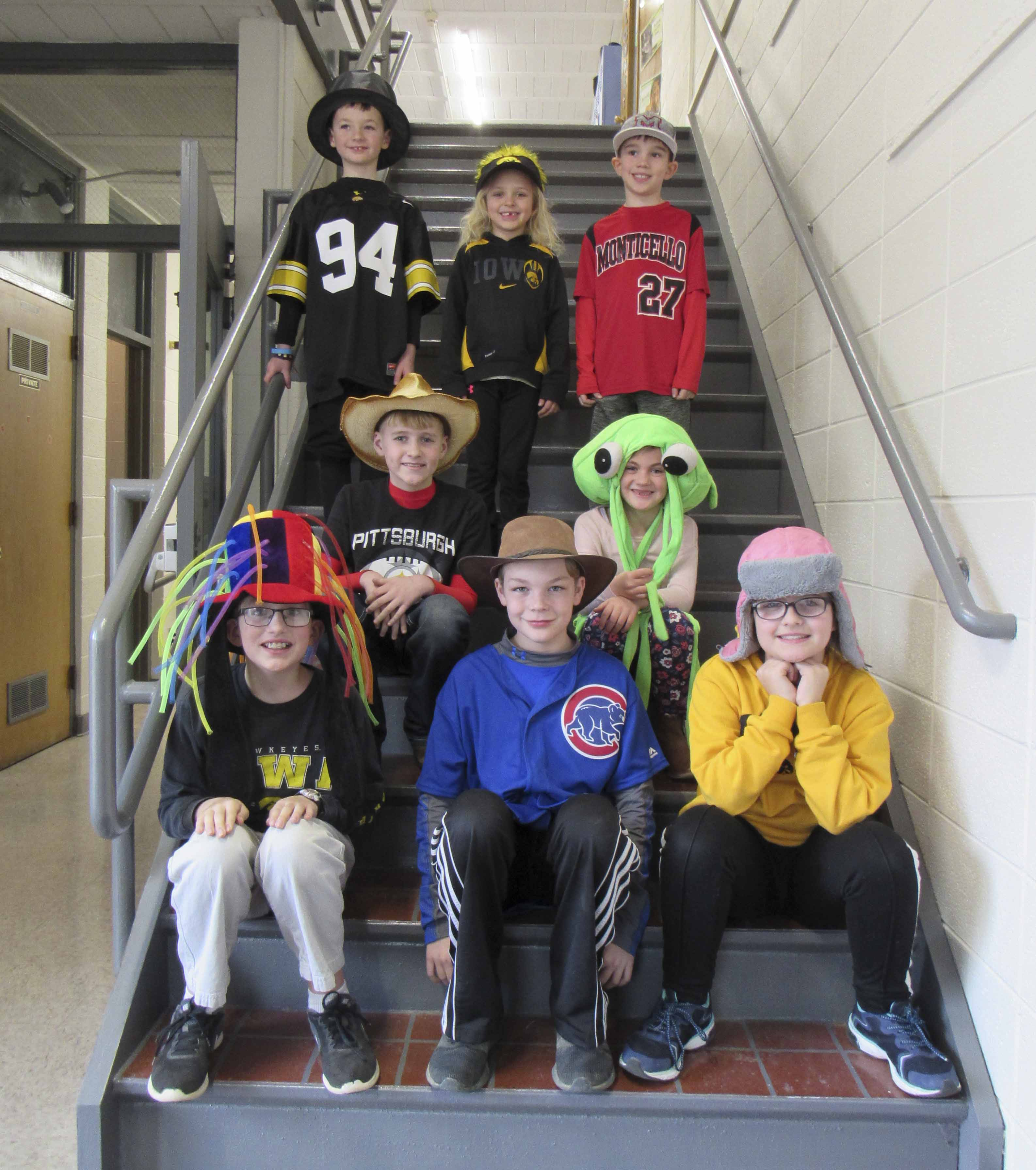 Students at Sacred Heart Catholic School celebrated Catholic Schools Week, Jan. 28-Feb. 3. Jan. 31 was Crazy Hat Day and Favorite Team Day. Seated in the front row from left are Alex Oswald, Royce Kiburz, and Lorelei Rieken. Second row, Dru Boffeli and Jordyn Stoll. Standing in back are Cooper Ehrisman, Whitney Long, Henry Hoeger. (Photo by Kim Brooks)
