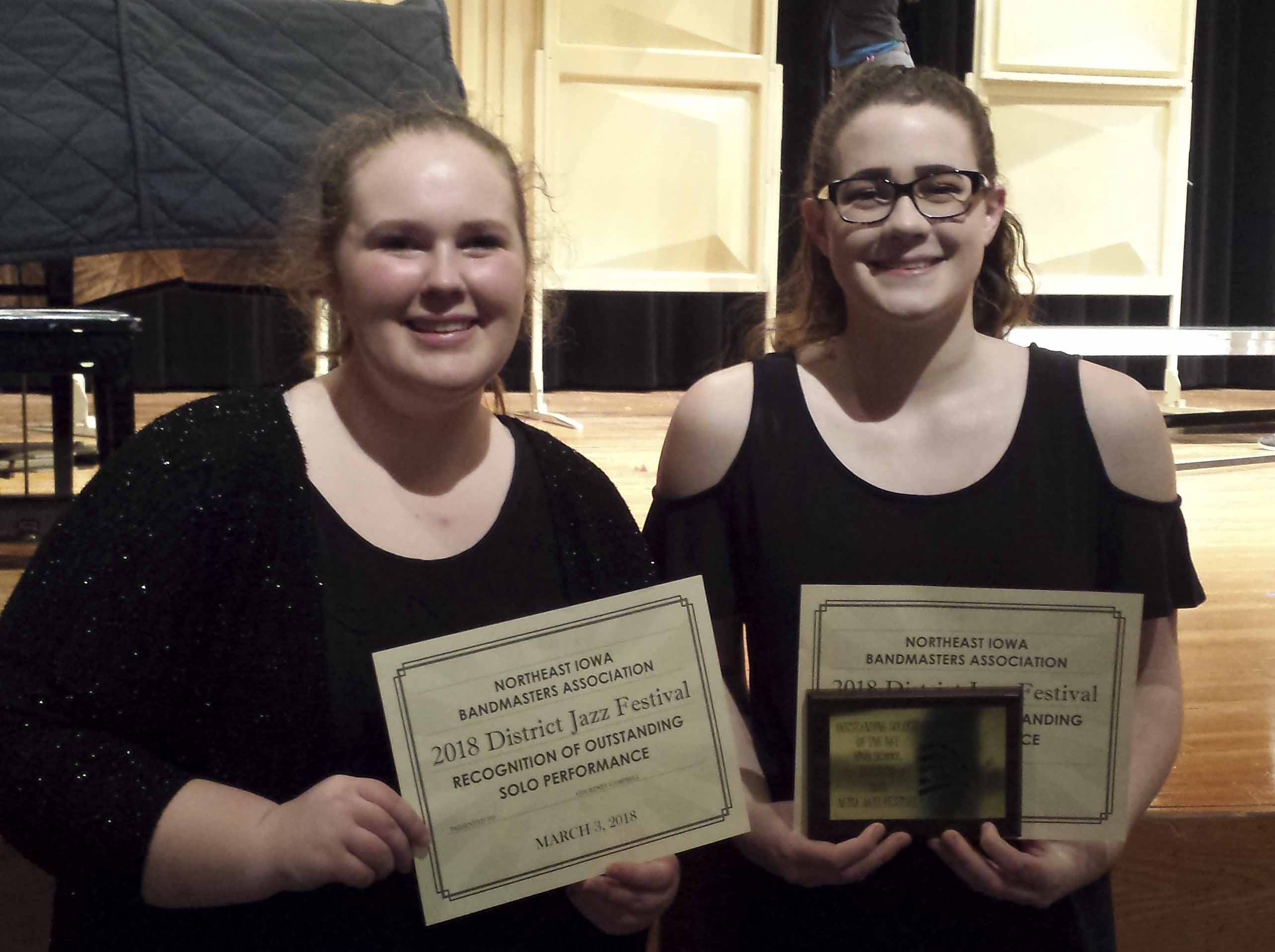 Courtney Campbell (left) and Makayla Coffey received outstanding soloist awards at the district contest, Campbell on trombone and Coffey on trumpet. Coffey was also named Outstanding Soloist of the Day. (Photo by Pete Temple)