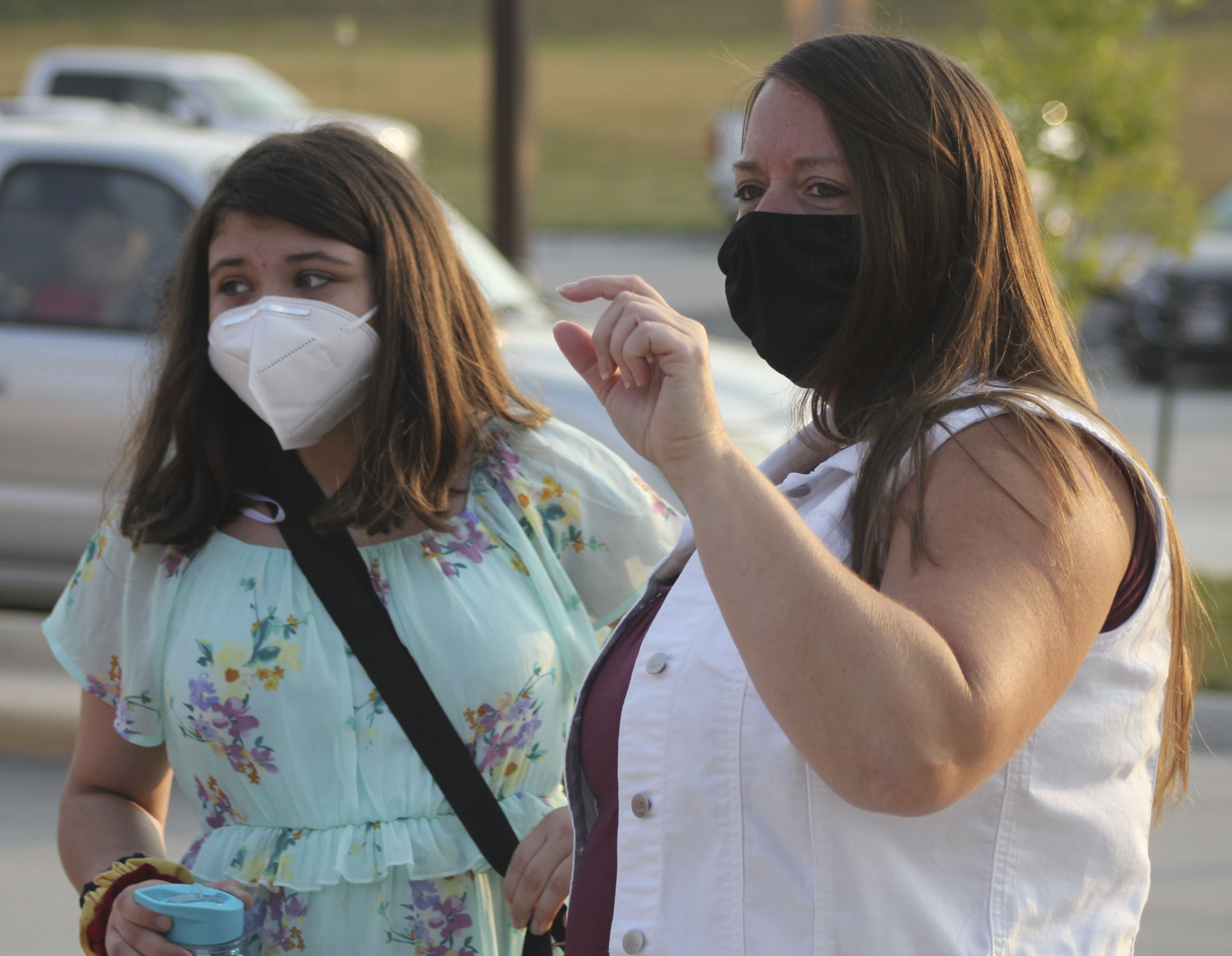 Monticello Middle School eighth-grader Adeline Wenger (left) receives guidance from middle school associate Dawn Bixler before entering the new building on the first day of school Aug. 24. (Photo by Pete Temple)