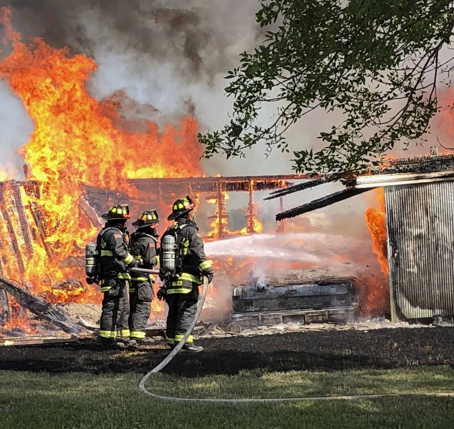 The Monticello Fire Department responded as flames consumed a garage at the Bob Helgens farm in rural Scotch Grove Aug. 3. (Photo by Mark Spensley)