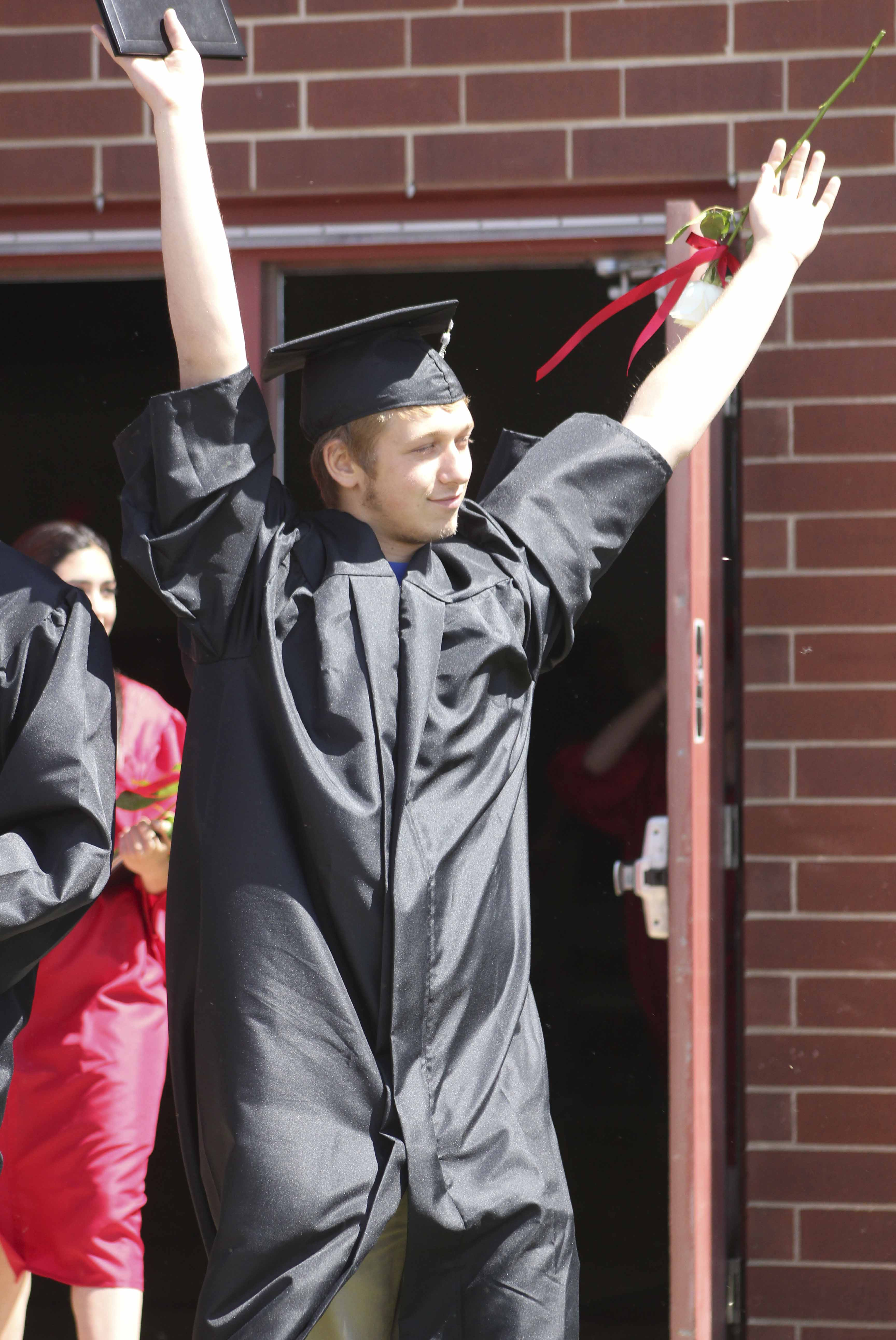 Jordan Breashears exults in the moment after Commencement.