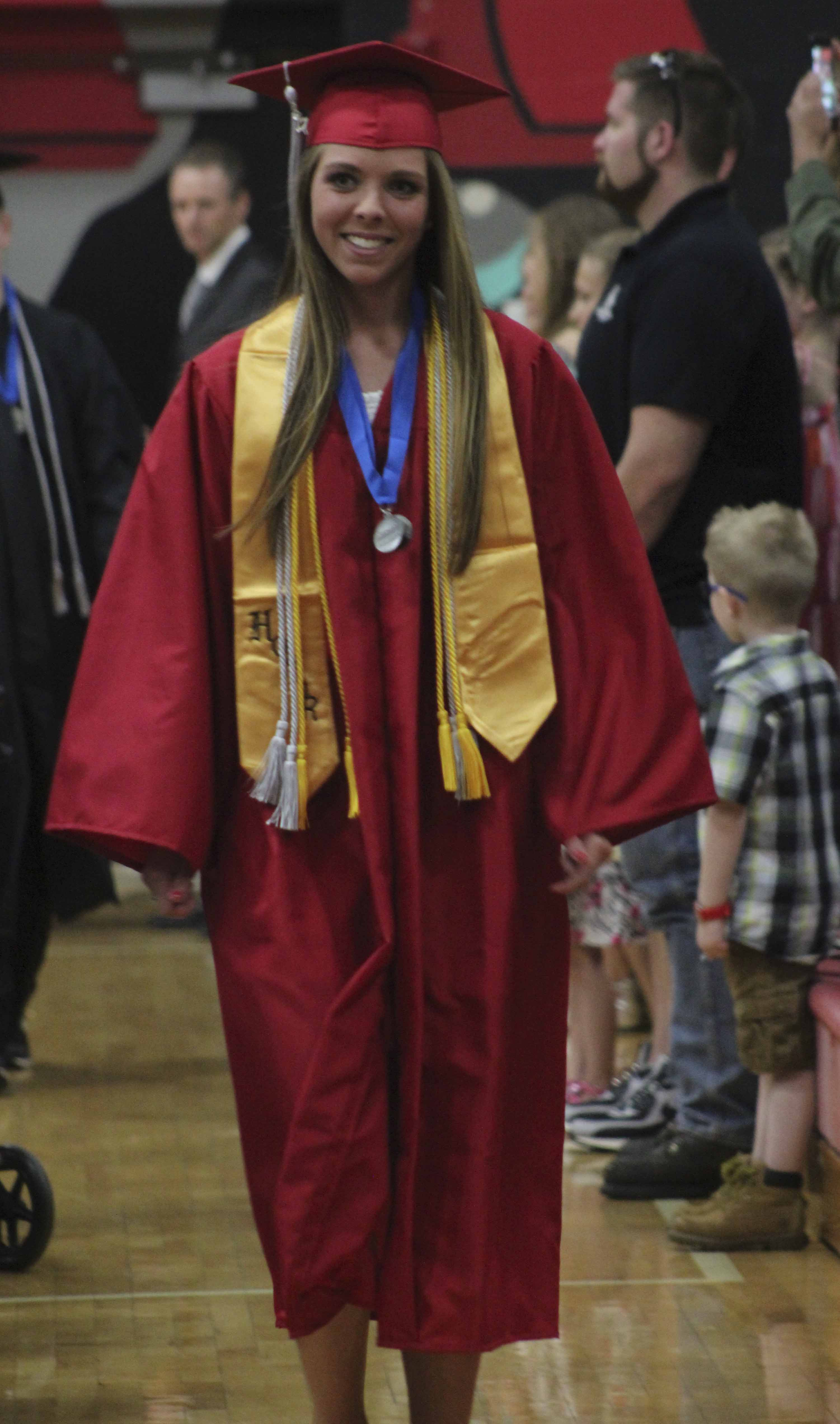Salutatorian Jacqueline Petersen enters during the processional.