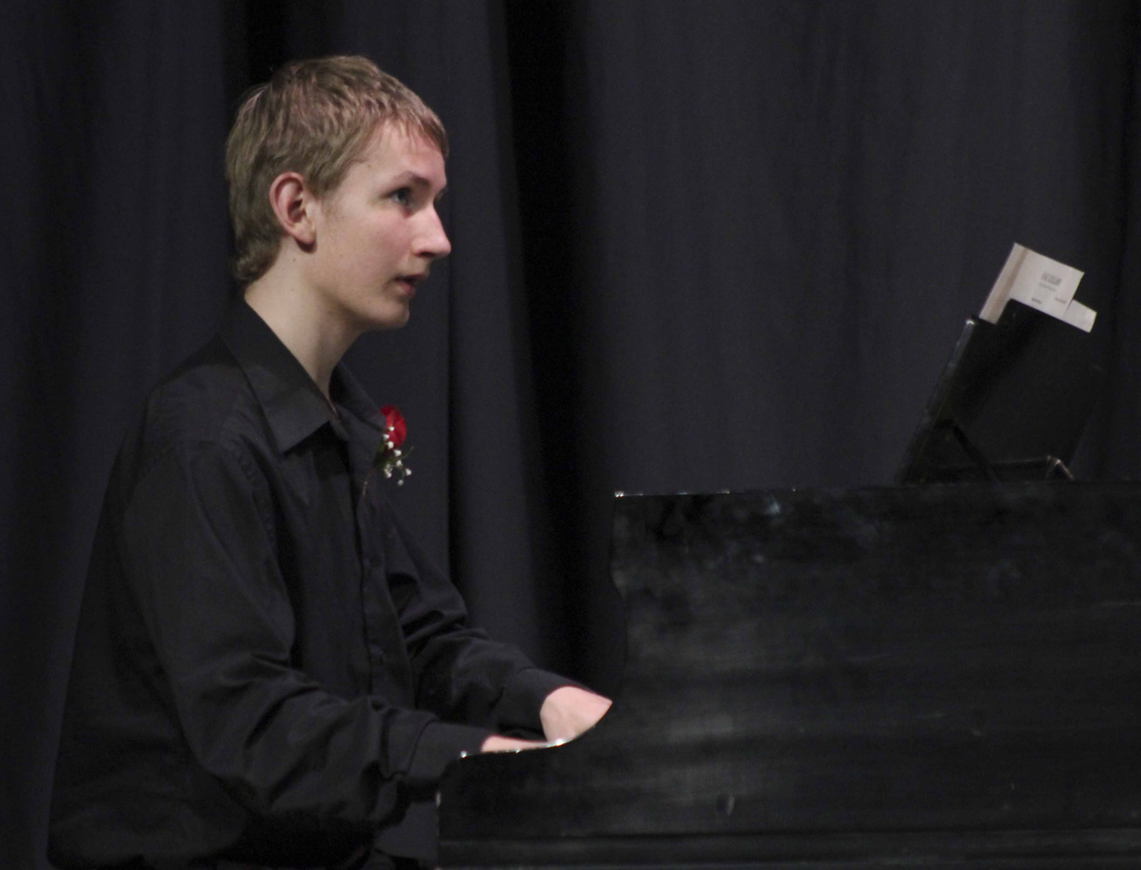 Senior Ryan Oswald performs a piano accompaniment during the Monticello High School band's IBA Preview Concert May 4 in the MHS Auditorium. (Photos by Pete Temple)