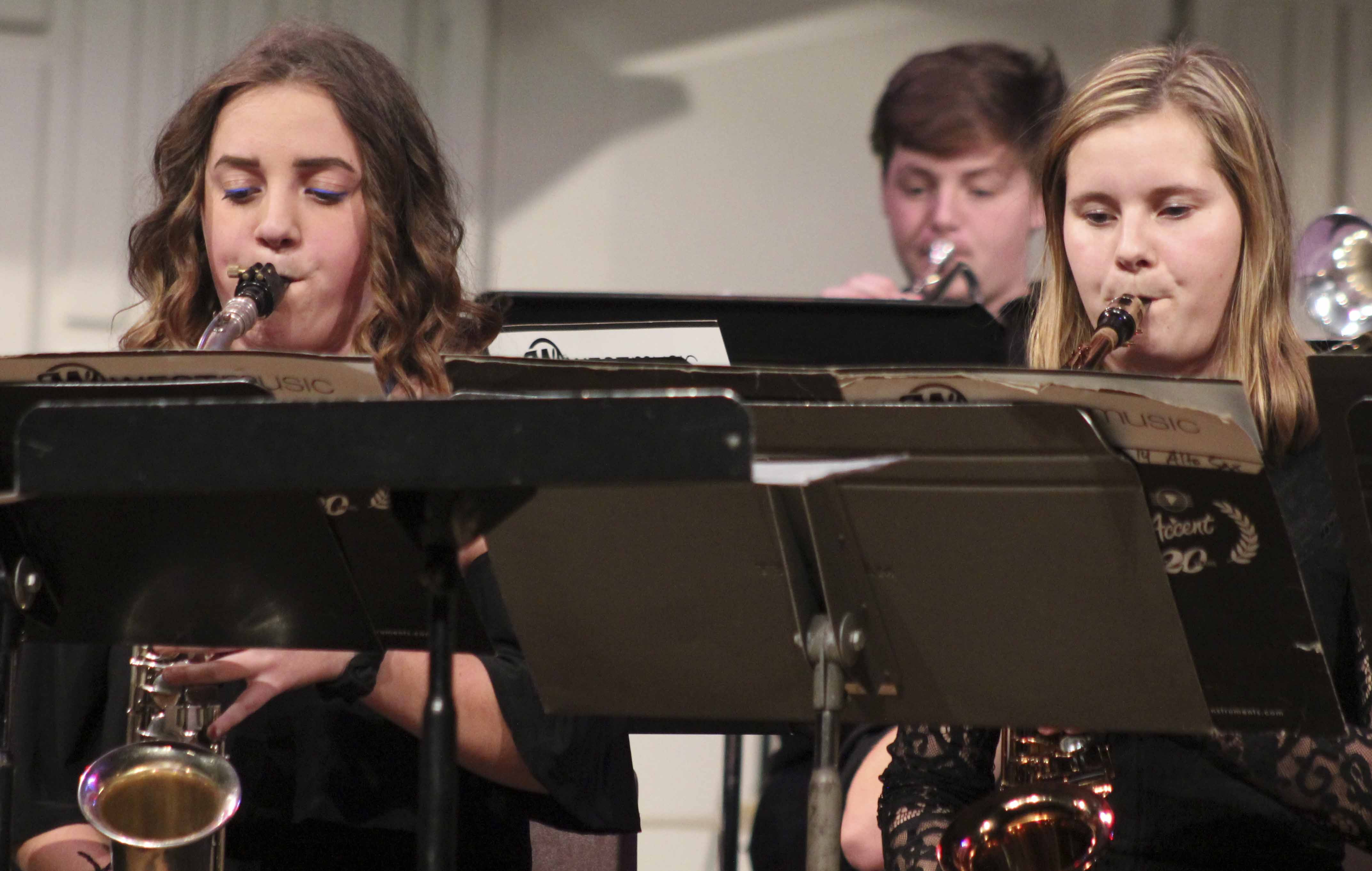 Saxophone players Micah Williams (left) and Sophia Ahlrichs perform during the jazz portion of the Monticello High School Band Winter Concert Dec. 20 in the MHS Auditorium. In back on trumpet is Keegan Freese. (Photos by Pete Temple)