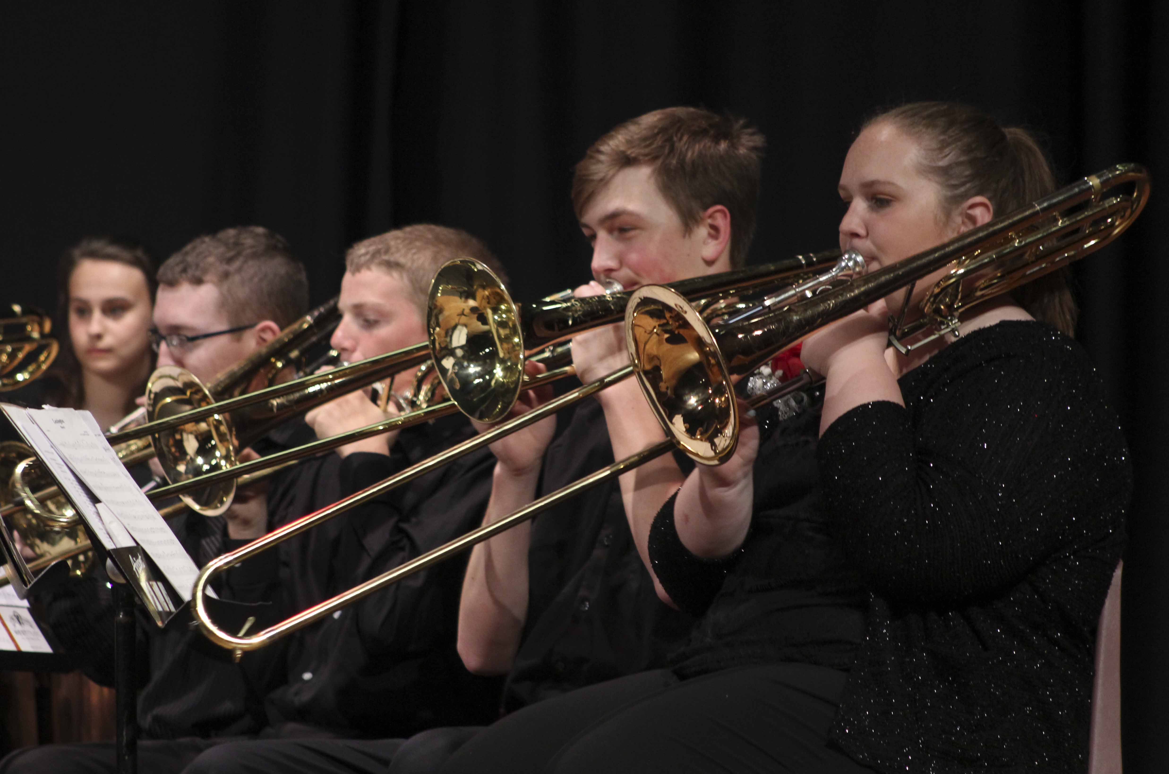 Trombone players (from foreground) Courtney Campbell, Jeff Carlson, Levi Temple and Gabe Wright perform during the IBA Preview Concert.