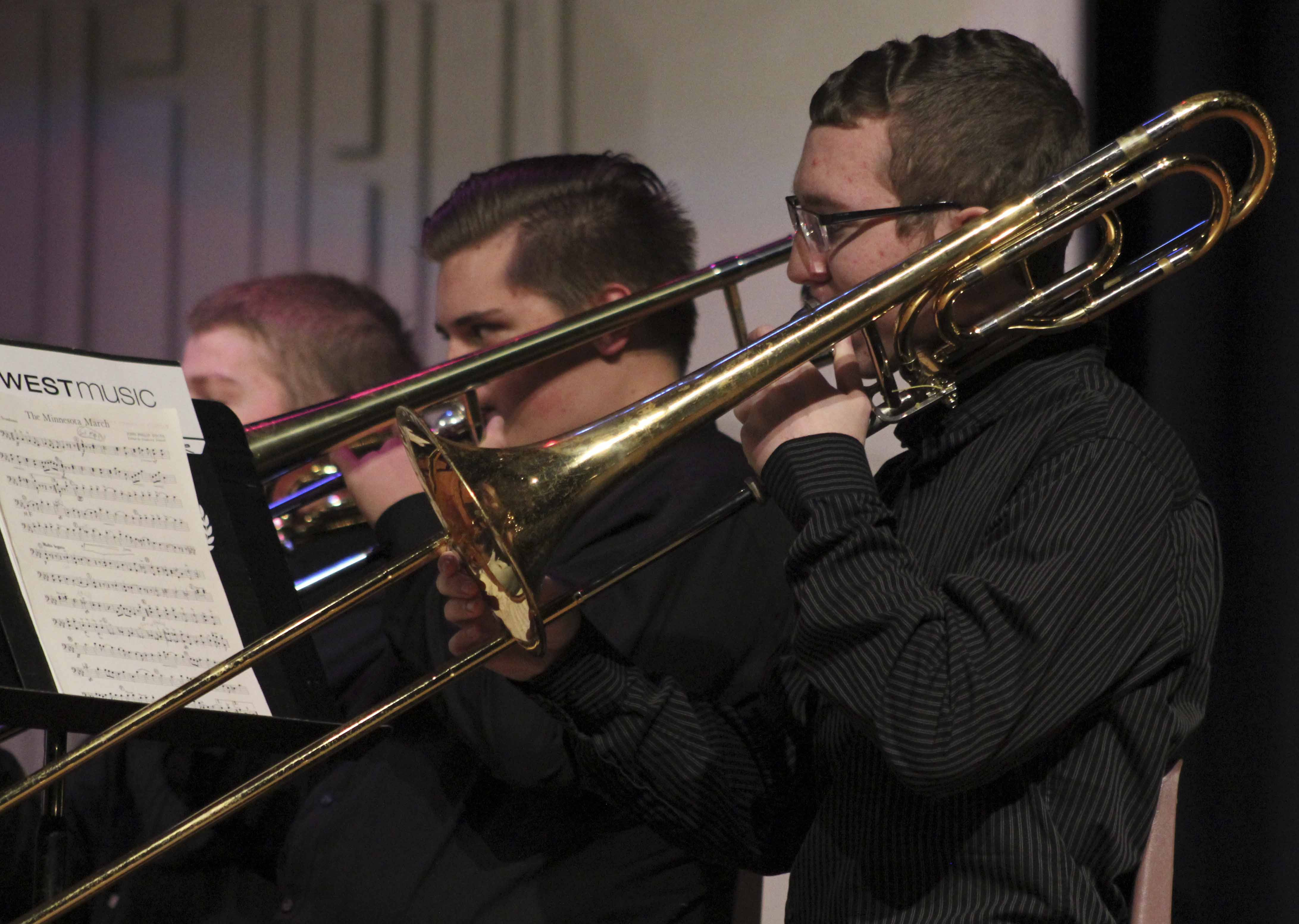 Trombone players Gabe Wright (front) and Davin Wickman play with the symphony band at Thursday's concert.