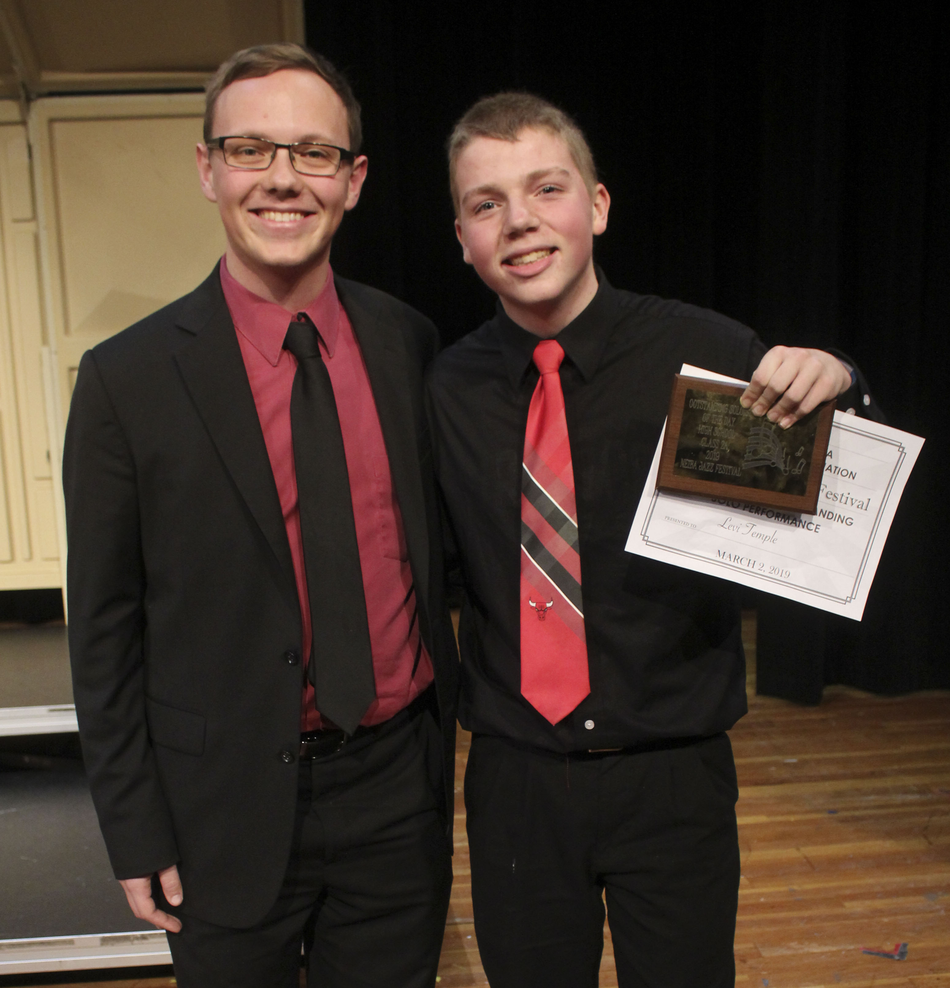 Sophomore Levi Temple (right) was named Outstanding Soloist at the NEIBA Jazz Festival. At left is director Alec Garringer.