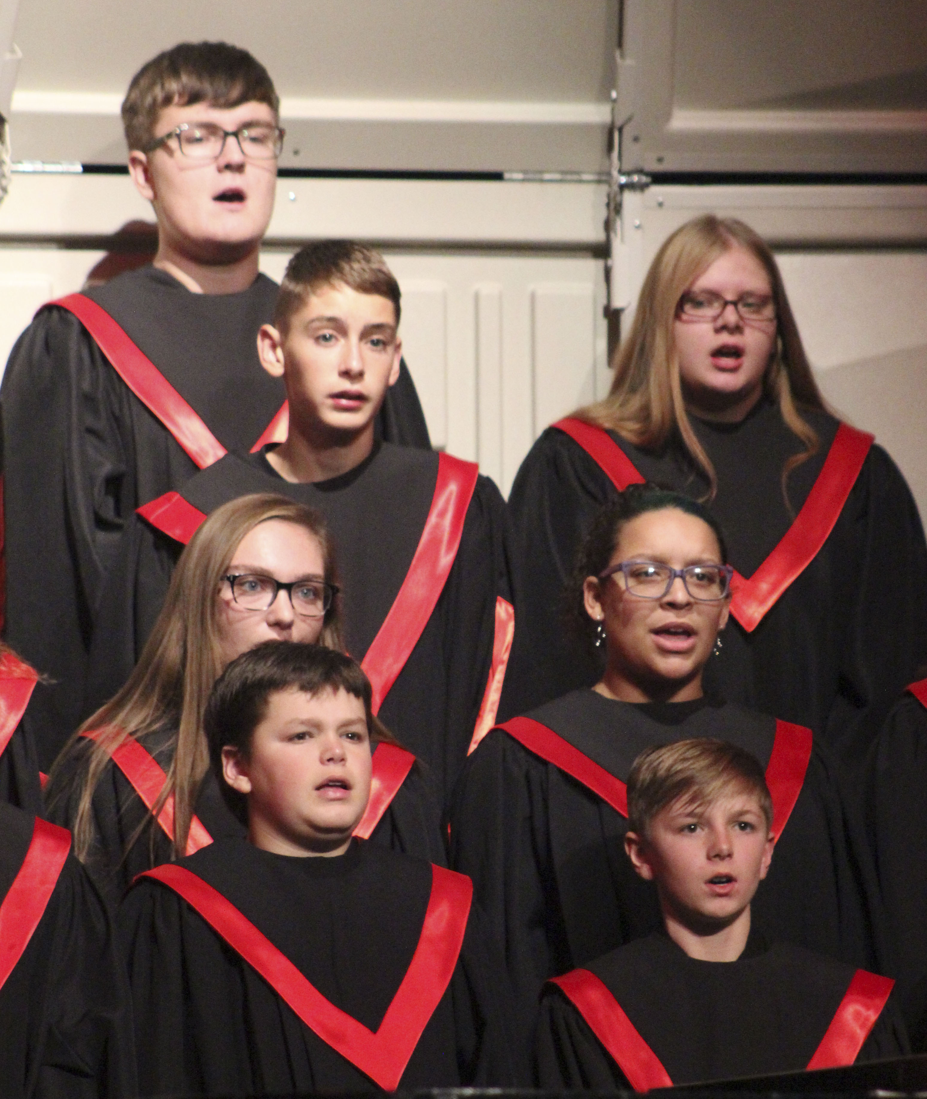 Members of the Mixed and Concert Choirs sing at the Oct. 17 concert. They include, clockwise from top: Will Dotterweich, Kadence Barnhart, Yasmin Al-Ansar Arnold, Chesney Capron, Zach Reuter, Marisa Grant and Noah Webber. (Photos by Pete Temple)