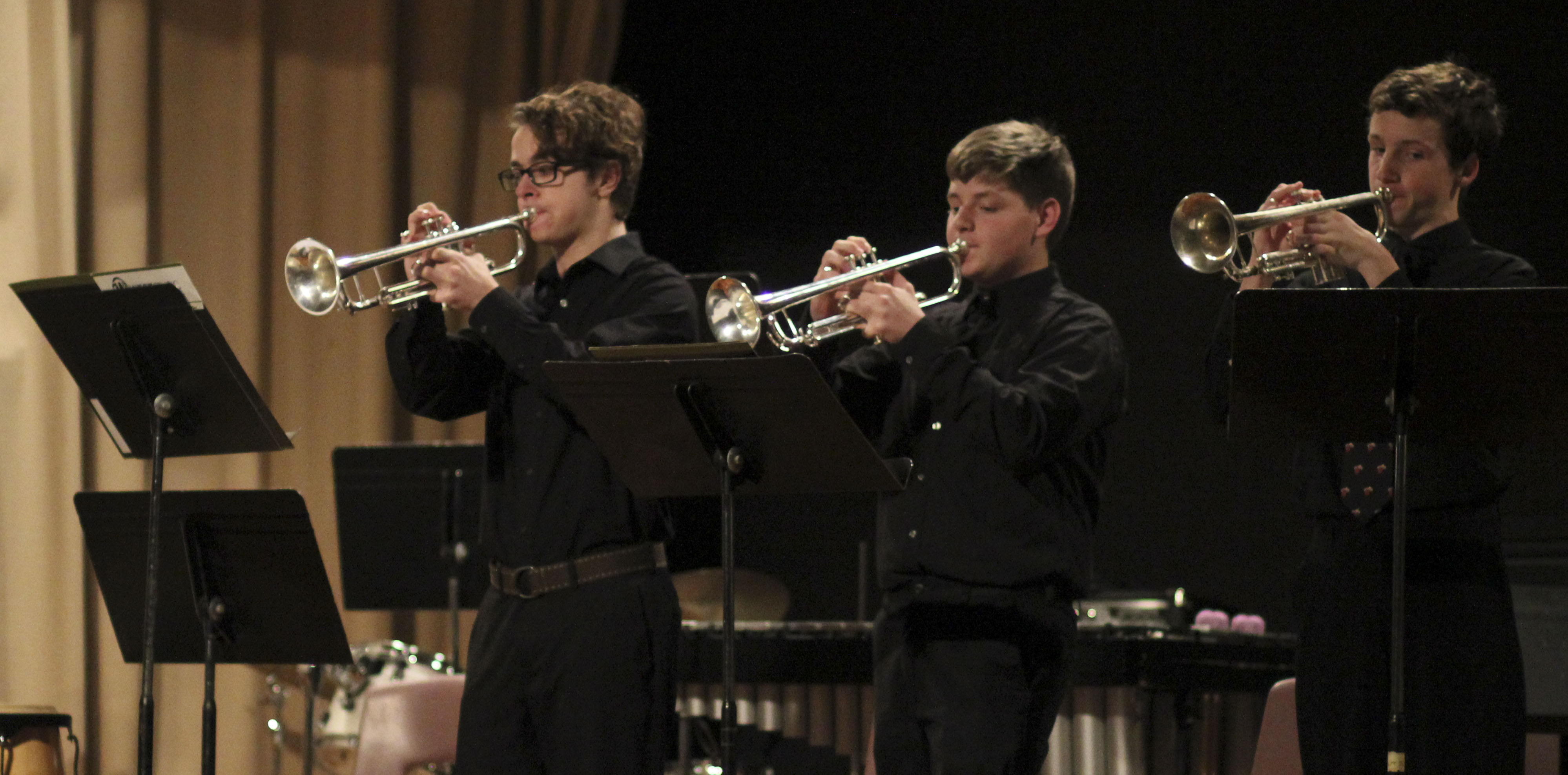 """Monticello trumpet players (from left) Noah Arduser, Keegan Freese and Ian Temple perform """"Bugler's Holiday"""" during Jammin' In January at the Community Building Jan. 6. (Photos by Pete Temple)"""