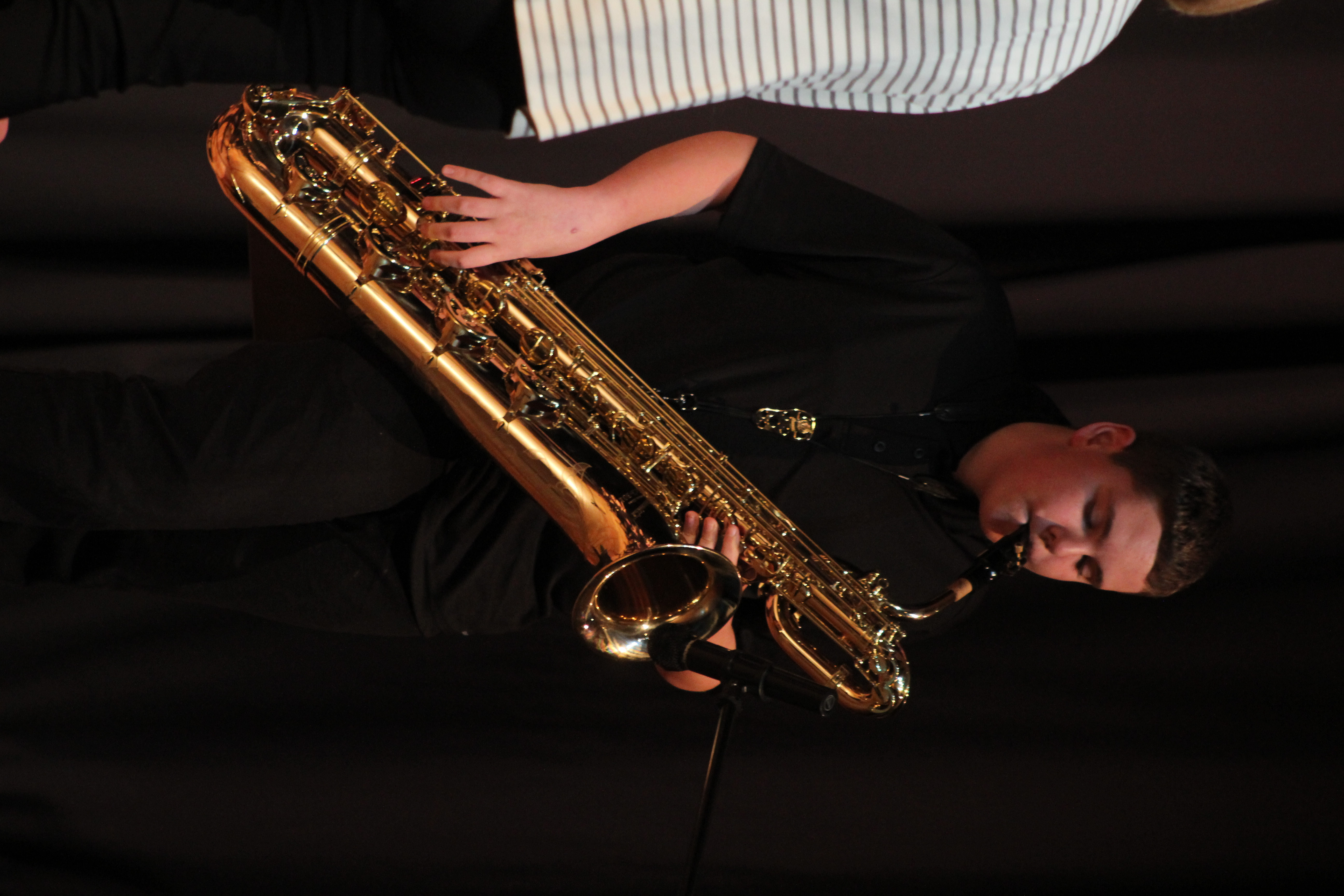 Gary Pasker of the Monticello Middle School Jazz Ensemble offers a solo on baritone sax Feb. 23.