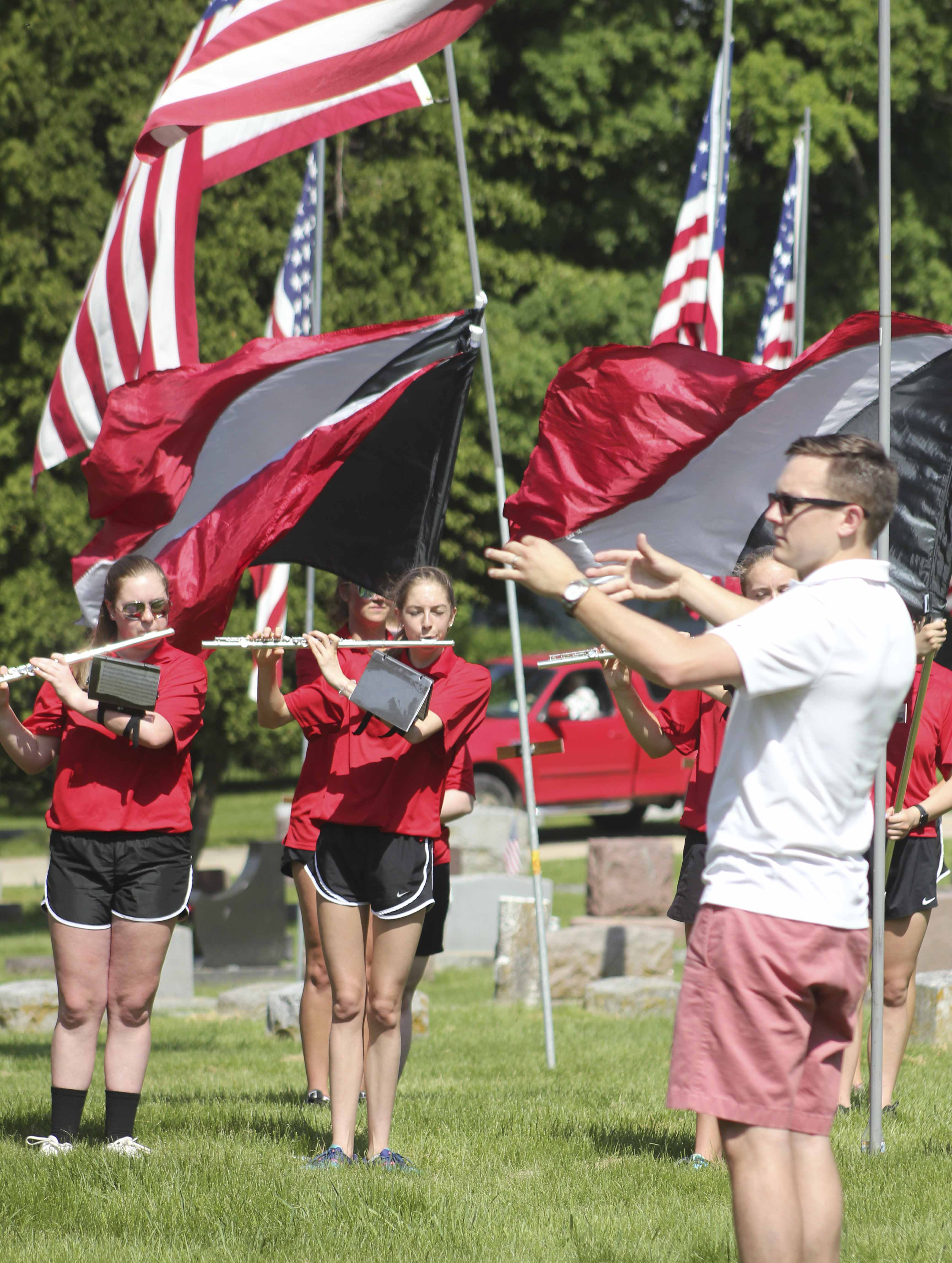Band members Kristen Roher (left) and Maddie Stadtmueller follow the direction of Mike Kowbel during Memorial Day ceremonies at Oakwood Cemetery May 28. (Photos by Pete Temple)
