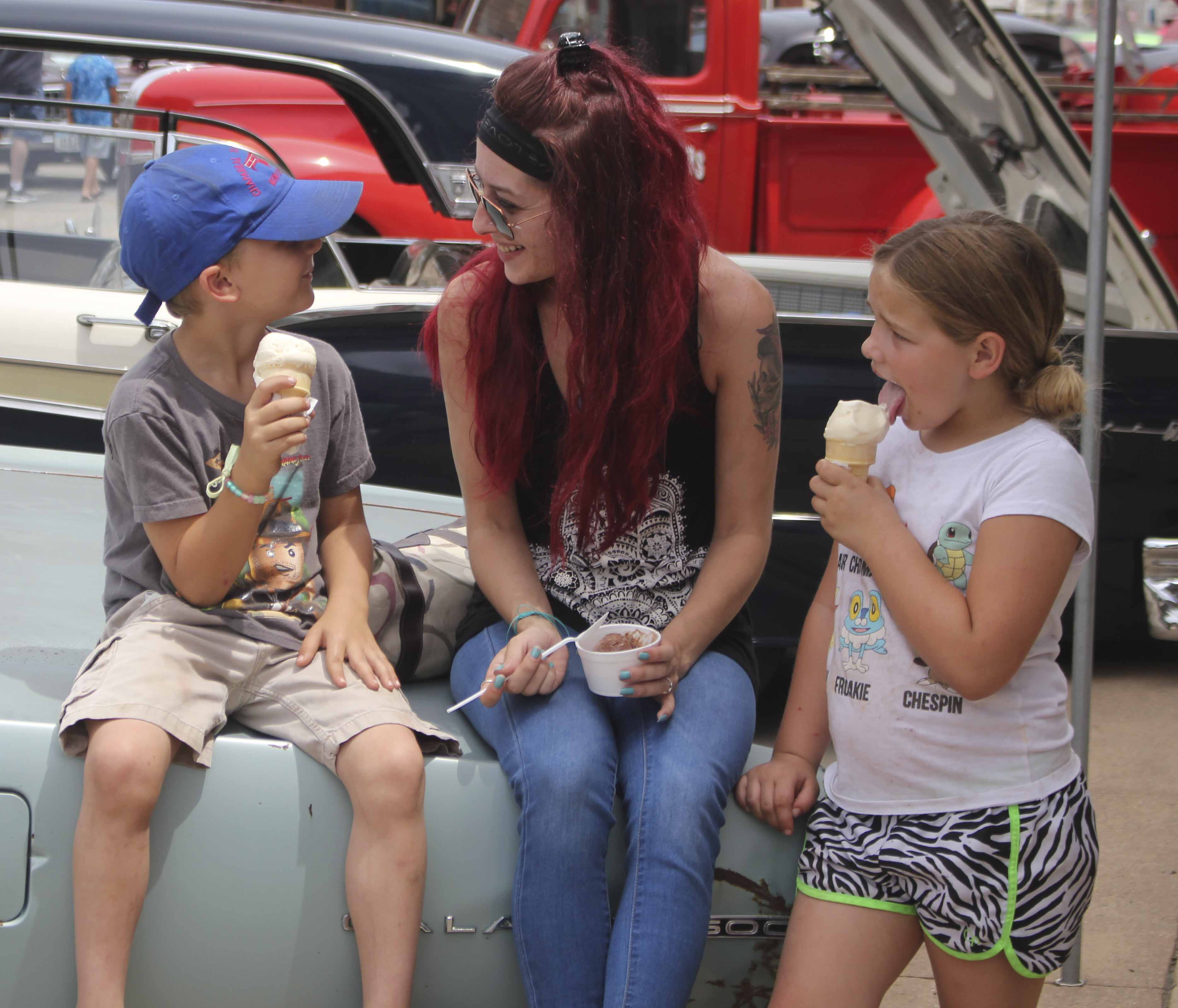 Enjoying an ice cream break during Monti in Motion are (from left) 6-year-old Kayden Lyon, Jess Lyon and 7-year-old Avrie Elliott. All are from Monticello.