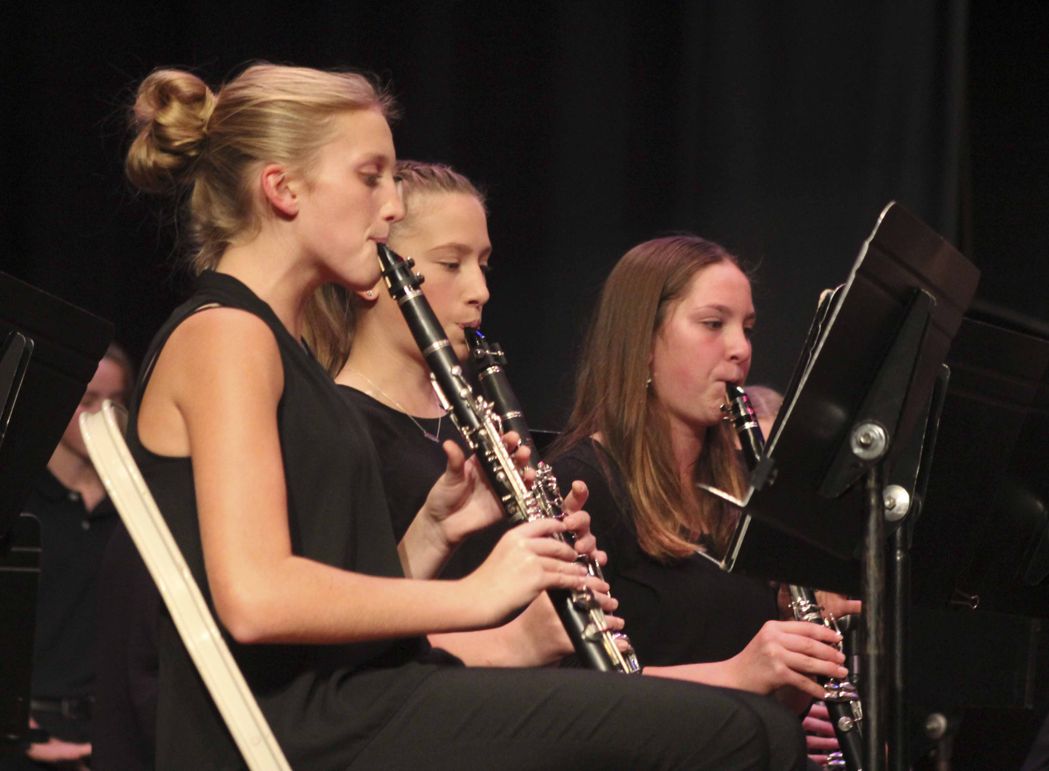 Clarinet players (from front) Karle Kramer, Nora Sperfslage and Katie Roher perform during the grade 7-8 portion of the Monticello Middle School Bands Fall Concert Oct. 26 in the middle school auditorium. (Photo by Diane Temple)