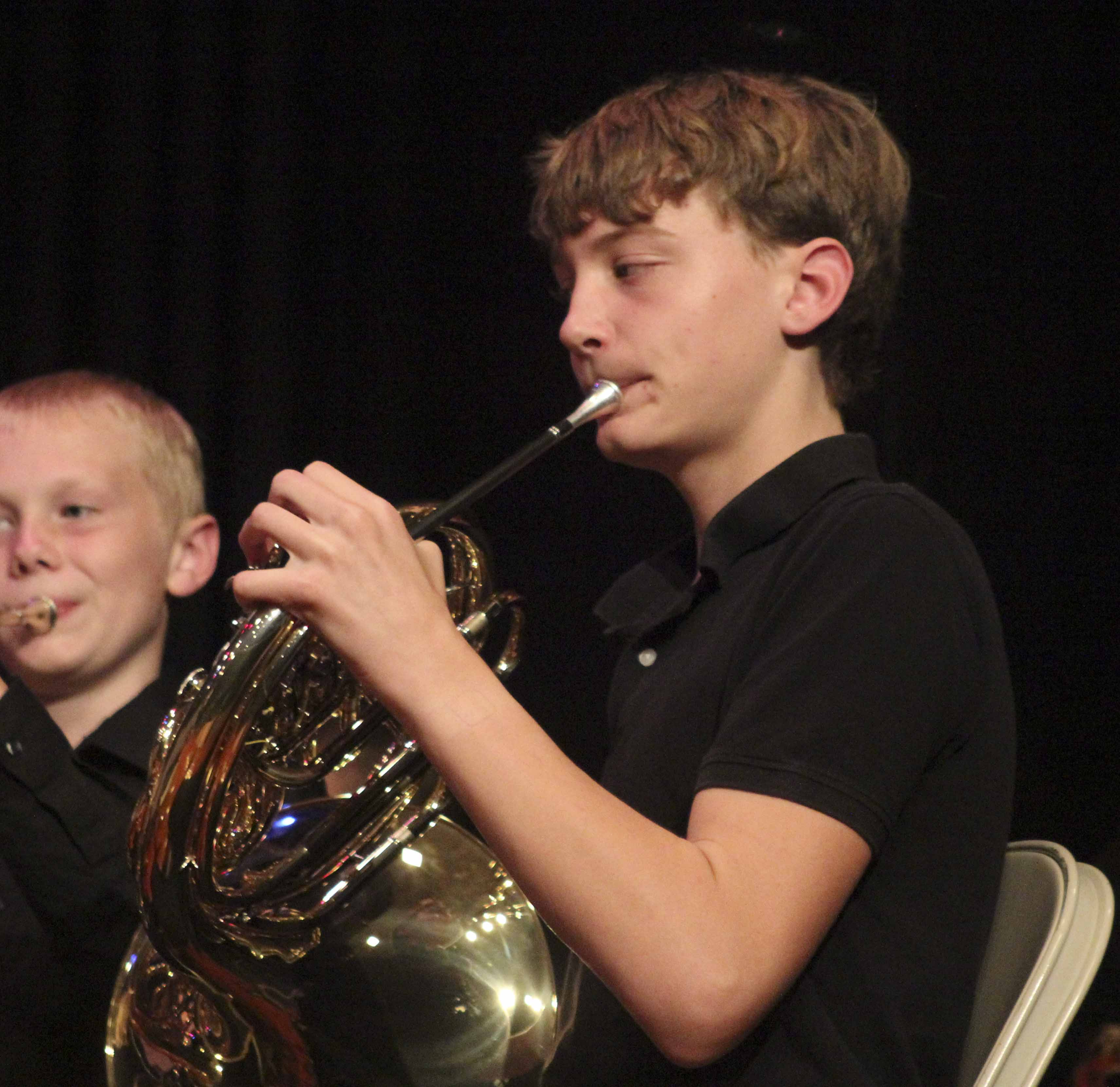 Sully Flynn (right) and Erlin Bell play French horn in the Oct. 26 middle school band concert. (Photo by Pete Temple)