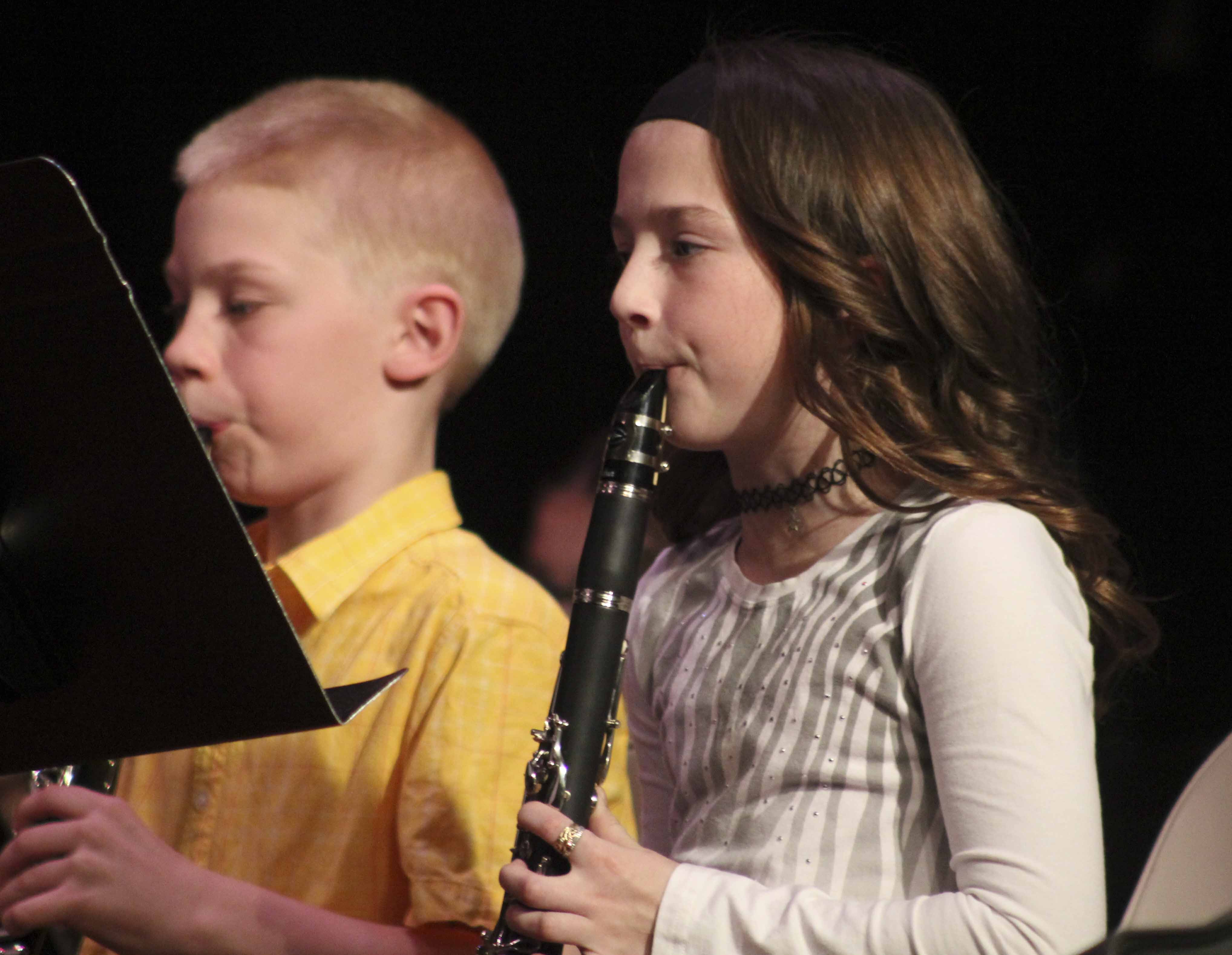 Playing clarinet with the fifth-grade band at the March 7 concert are Carter Martin (left) and Kendra Jacobs.