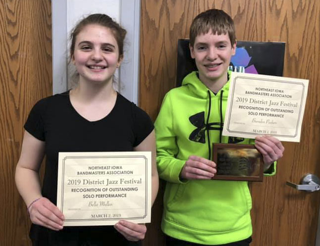 """The Monticello Middle School jazz ensemble received a Division """"I"""" rating at the NEIBA District Jazz Festival. Brendan Pasker (right) was named Outstanding Soloist, and Bella Mullen received an honorable mention award. (Photo by Diane Temple)"""