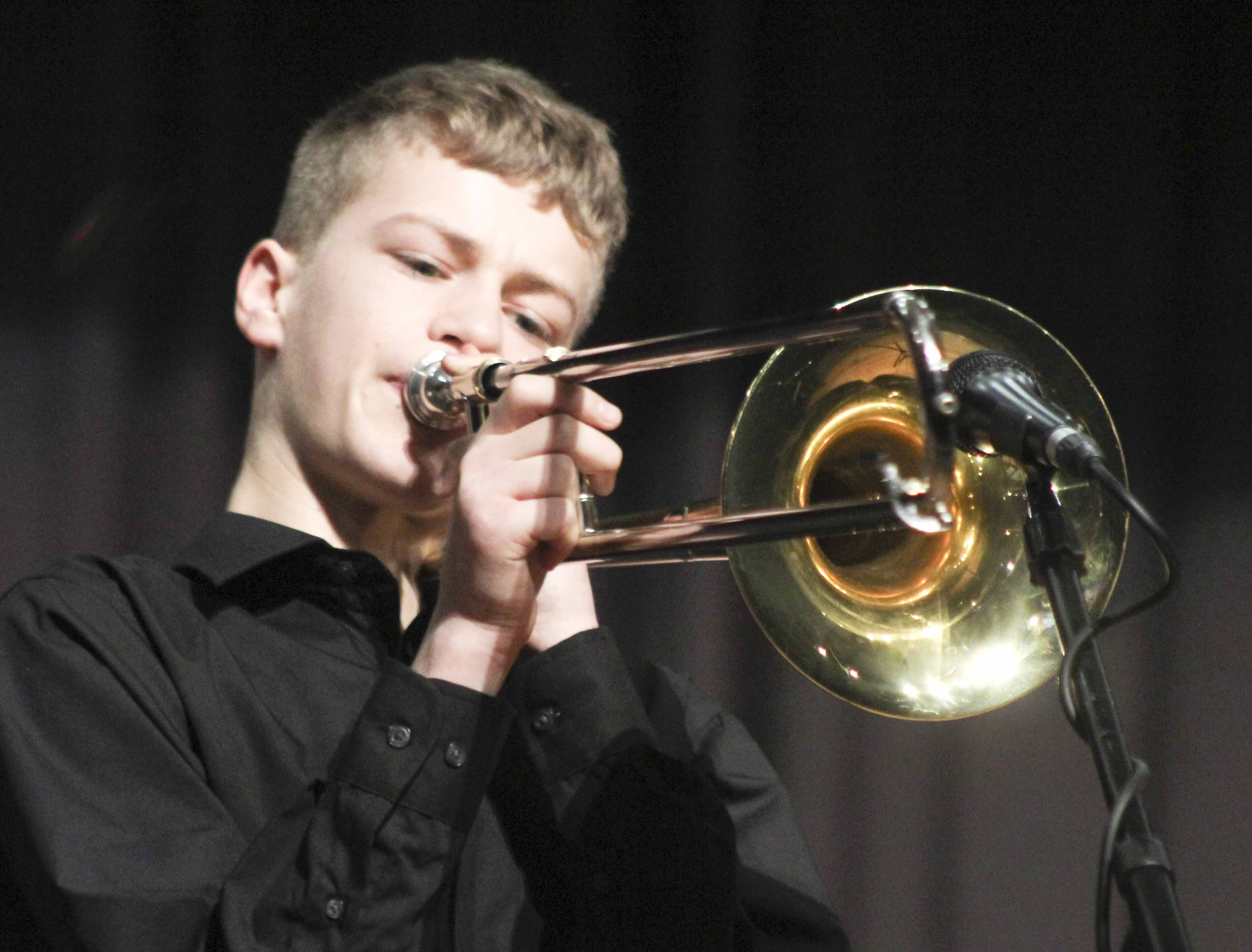 Austin Kurt plays a solo on trombone as the middle school jazz band performs at the Feb. 22 concert.