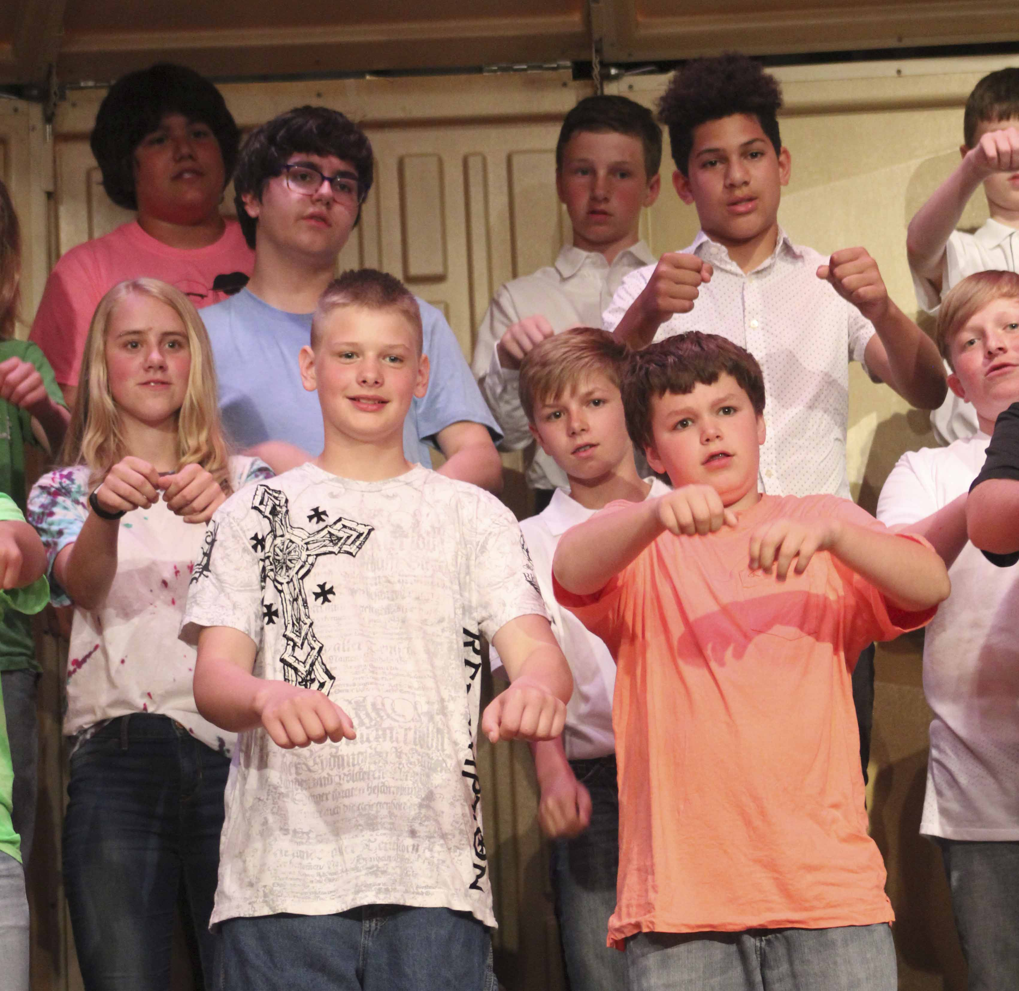 """A Cinematic Celebration"" was the theme of the grade 7-8 vocal concert May 21 in the Monticello Middle School Auditorium. Performers included, first row from left: Trey Brady and Zach Reuter. Second row: Serena Brokaw and Chesney Capron. Third row: Brodie Clemmons and Caelum Jones. Fourth row: Ian Taylor and Ian Temple. (Photos by Pete Temple)"