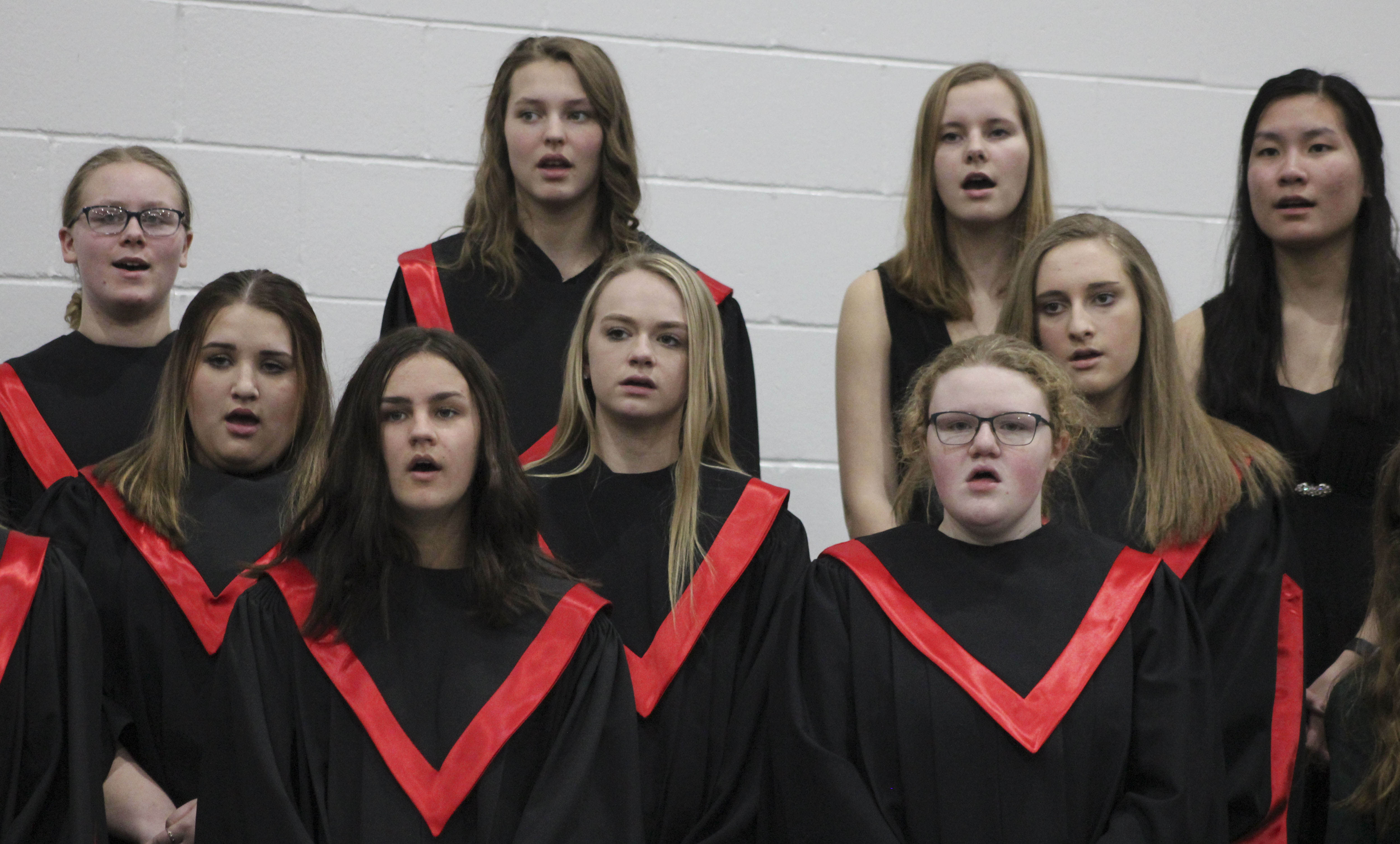 High school vocalists sing at the Grade 7-12 All-Vocal Concert March 14 in the Monticello High School gym. They include, first row from left: Brooklyn Stark and Mary Schmit. Second row from left; Ami Schwendinger, Kelsey Adams and Kayla Simmons. Third row: Trista DeShaw, Triniti Etzel, Sophia Ahlrichs and Clara Finger. (Photos by Pete Temple)