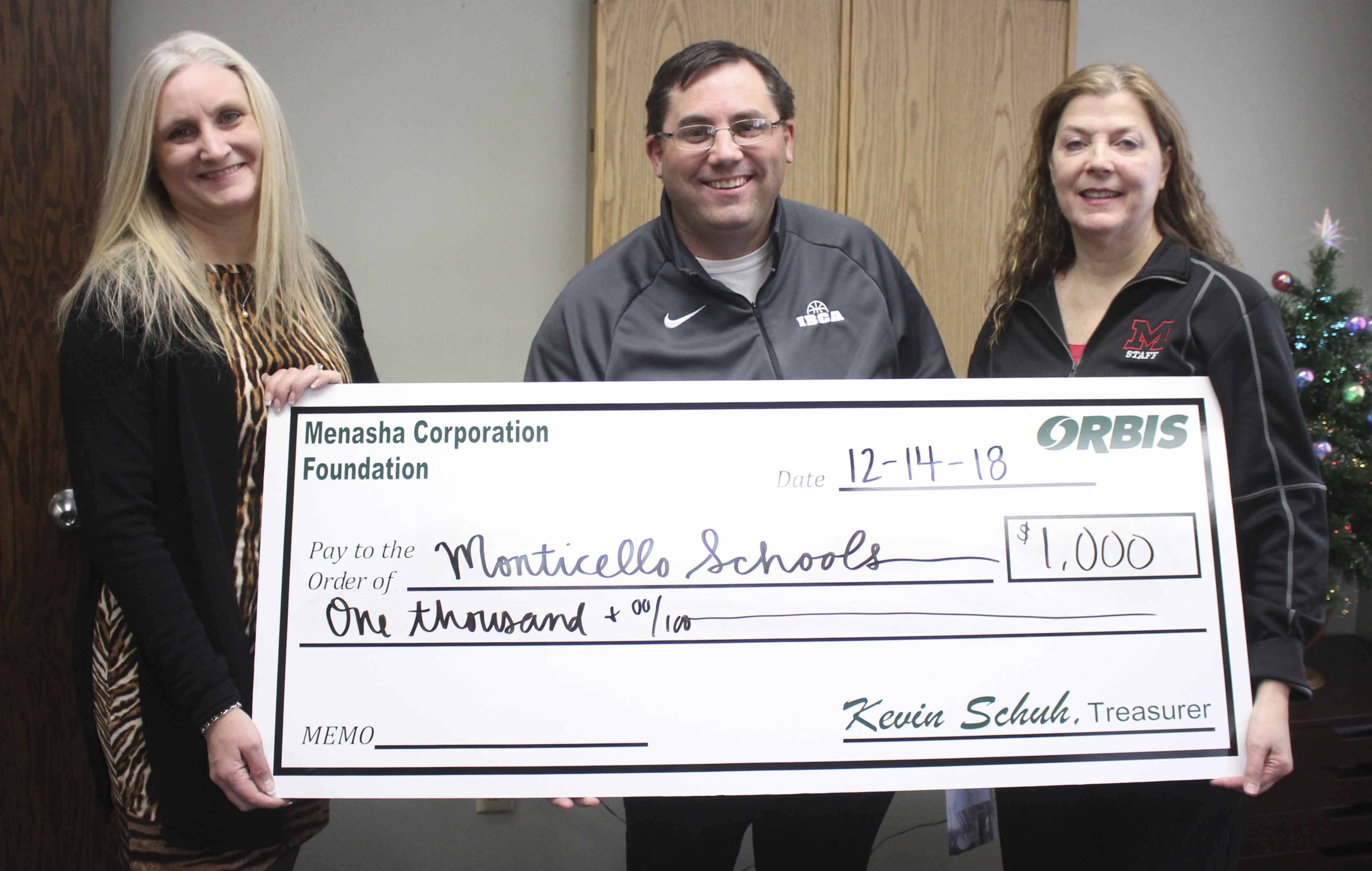 Monticello's middle and high schools received a donation of $1,000 from Orbis. From left are Lynnette Martineau of Orbis, Tim Lambert and Joan Young from Monticello schools.