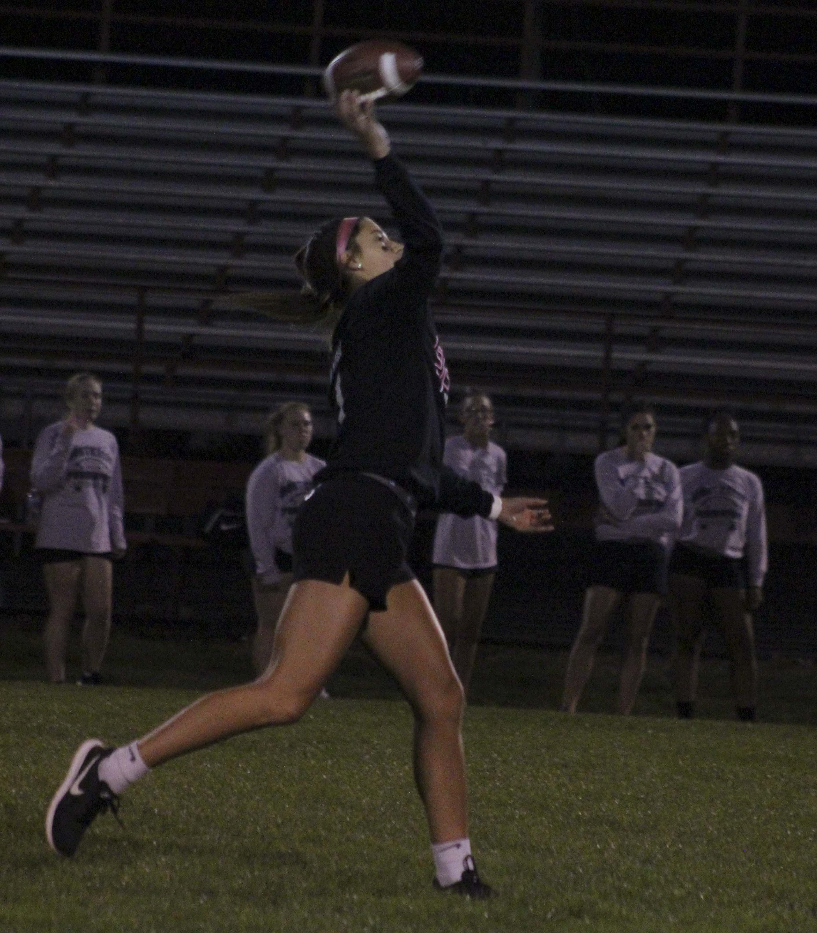 Karli Recker throws a pass for the Seniors during the annual Homecoming Powderpuff football game Sept. 21 at Dean Nelson Field. The Seniors defeated the Juniors 24-6.