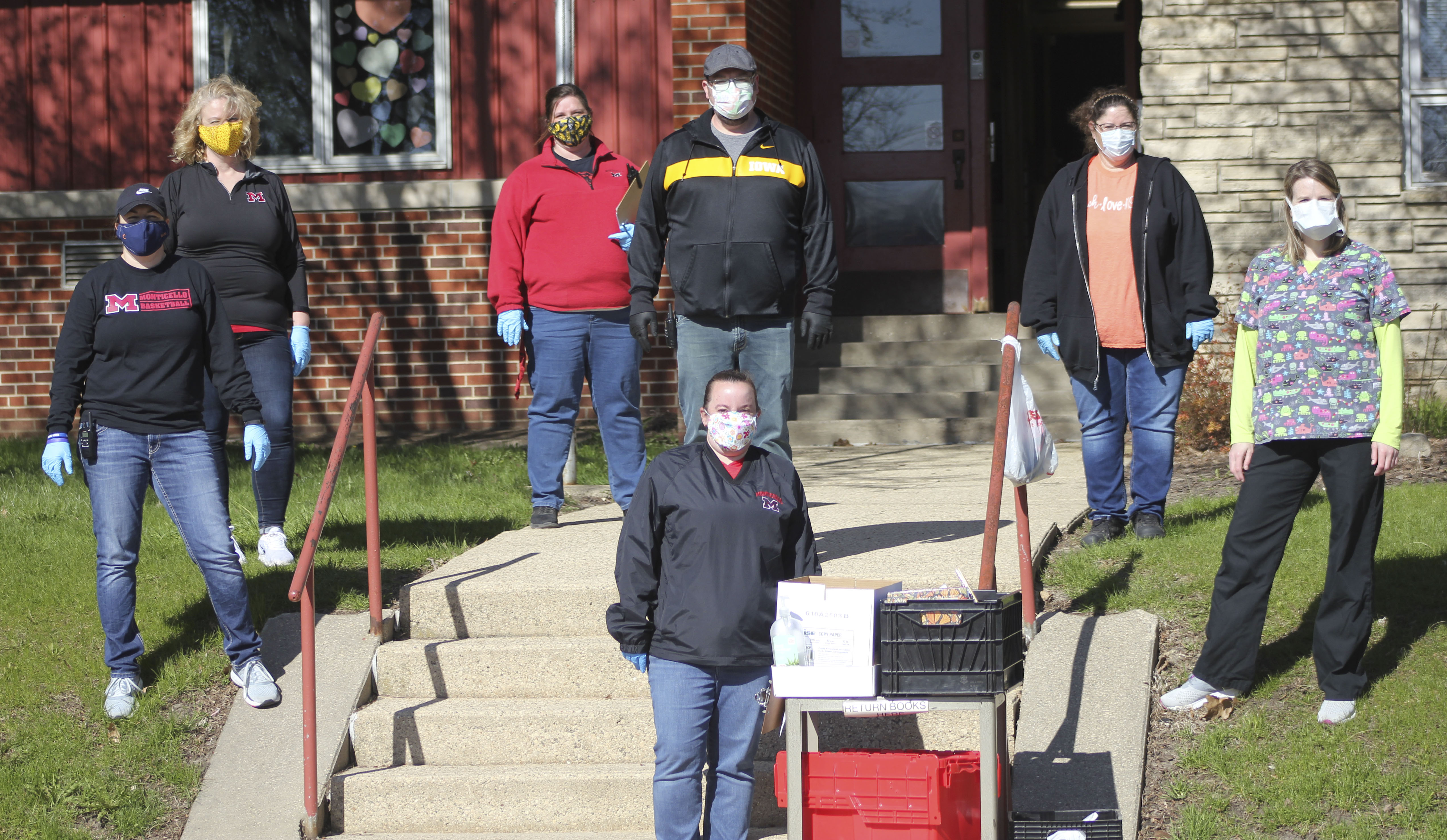 School district employees wear their masks and keep their distance as they wait to bring school supplies to Carpenter Elementary students. They are, front: Heather Hansen. Second row from left: Andrea Janssen, Karla Stahlberg, Robyn Ponder, Nick Thumma, Steph Isaac and Jennifer Speltz.