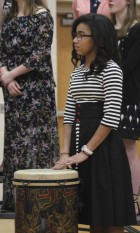 Saqua Werling adds percussion to one of the vocal pieces March 20.
