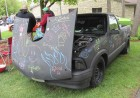 The annual Cruisin' for Camp Courageous classic car show, presented by the Cedar Valley Street Rods, was held on May 20 at Camp Courageous. Despite the cool weather, the rain held off long enough for the popular event. Dennis Bates of Monticello displayed his 1996 pickup truck that he painted black using chalkboard paint. Kids of all ages (and some adults) used their artistic skills to decorate the truck that was located at the front entrance.
