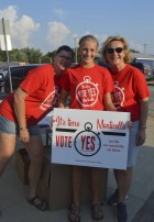 Many people who attended the tailgate wore their 'Vote Yes' t-shirts in support of building a new middle school. A few of the supporters are pictured, including Sandy Hinrichs, Karle Kramer, and Sheila Tjaden. (Photo by Hannah Gray)