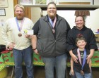 The top three winners of Amber's Chili Cook-off received special medals. From left are Tim Oberbreckling, first place with his Sweet & Sexy chili; Bobby Krum, second place with his Bowls of Steel chili; and Summer and Archer Krum with their Southwest Chicken Chili. Oberbreckling also received a $50 gift certificate to Teddy's Barn & Grill in Amber.