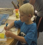 Noah Dorell, 6, shows off his architectural skills during the program, which was held on Tuesday, June 26.