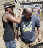 Jackson Snyder shaves the head and beard of his brother, John, in an effort to raise money for the Austin Strong Foundation. Monticello was one of the several stops on the 6th Annual Austin Strong Ride.