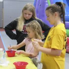 Kennedi and Blakelyn McNally and Kelsey Kremer make some homemade slime. There were activities for kids of all ages at Austin's Family Fun Night.